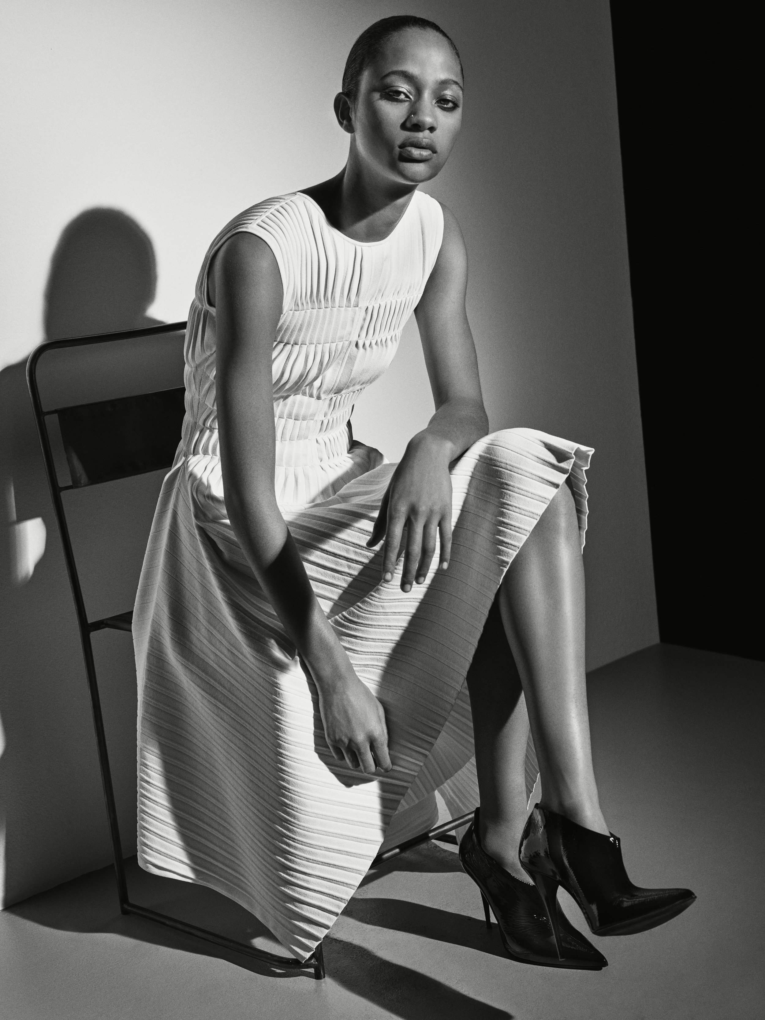 Look 7 White pleated knit dress.