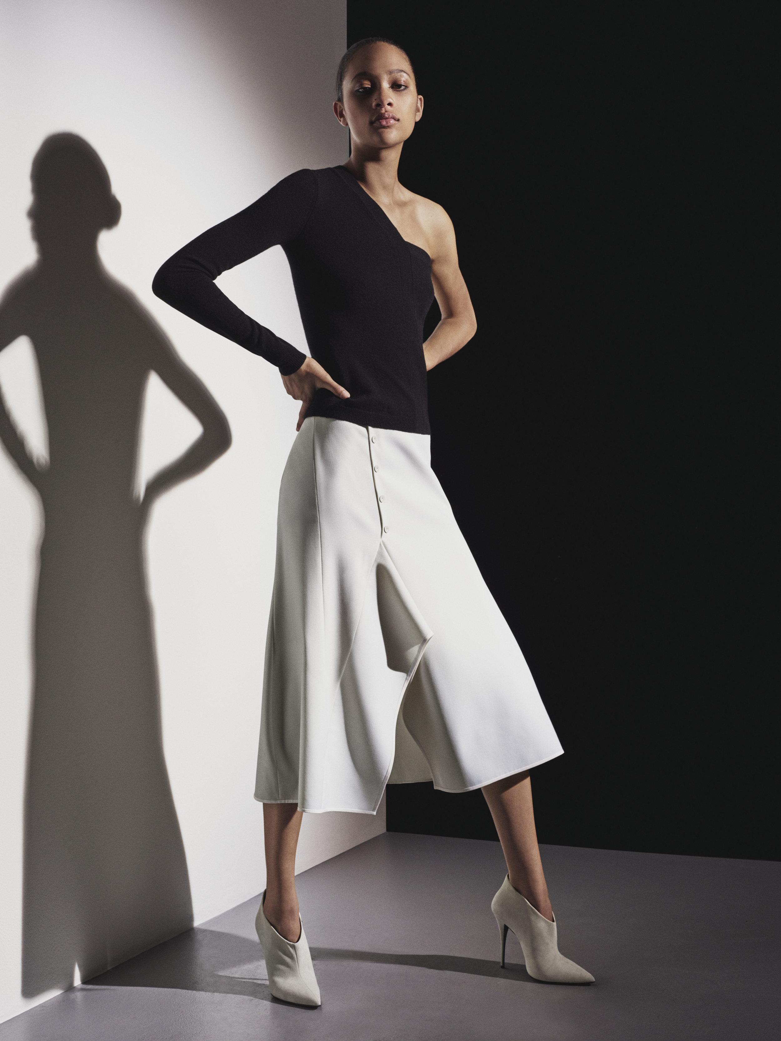 Look 10 Black one-shoulder knit top with white wool gabardine skirt.