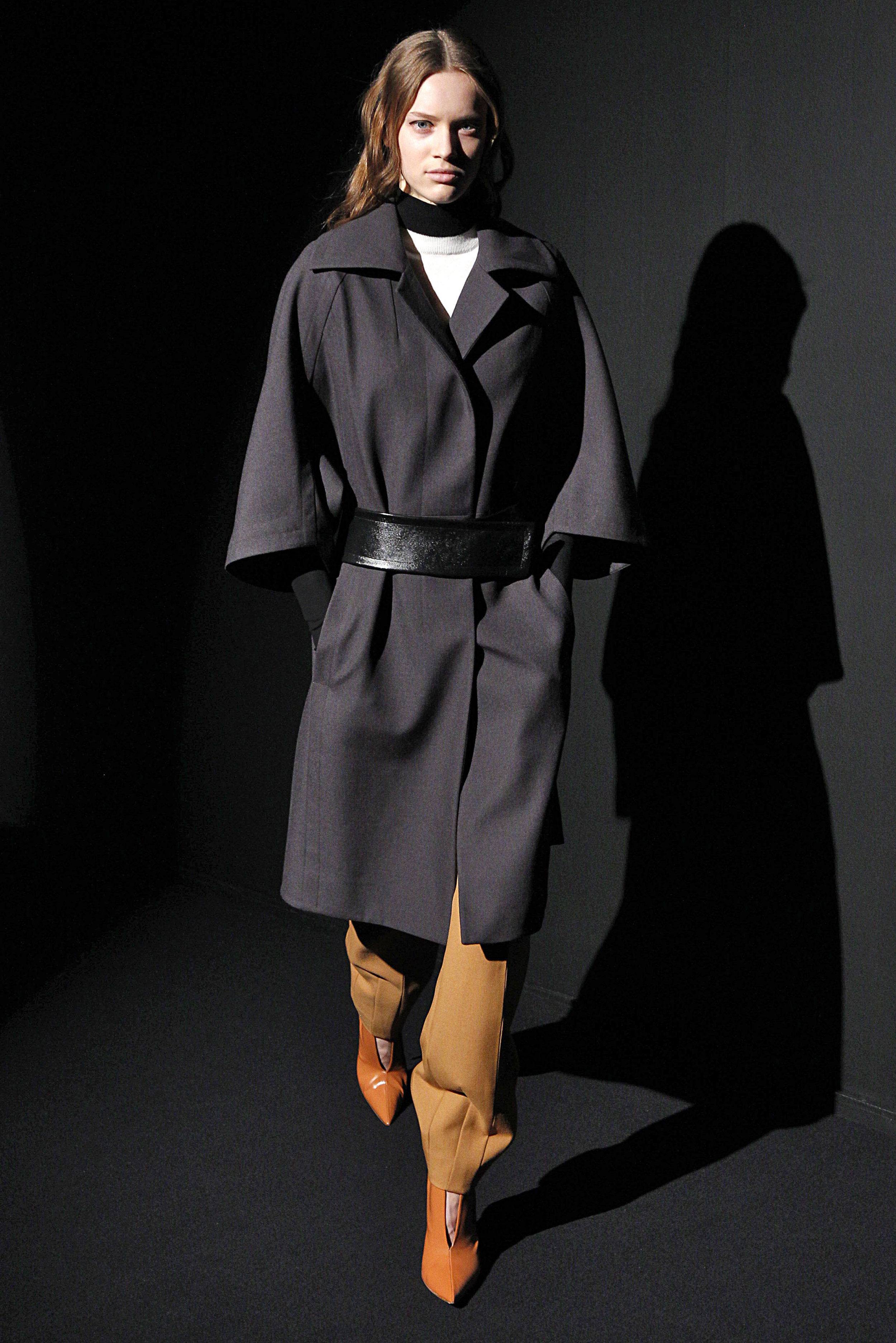 Look 2 Charcoal wool coat over black/white long sleeve turtle neck with bronze wool twill pant.