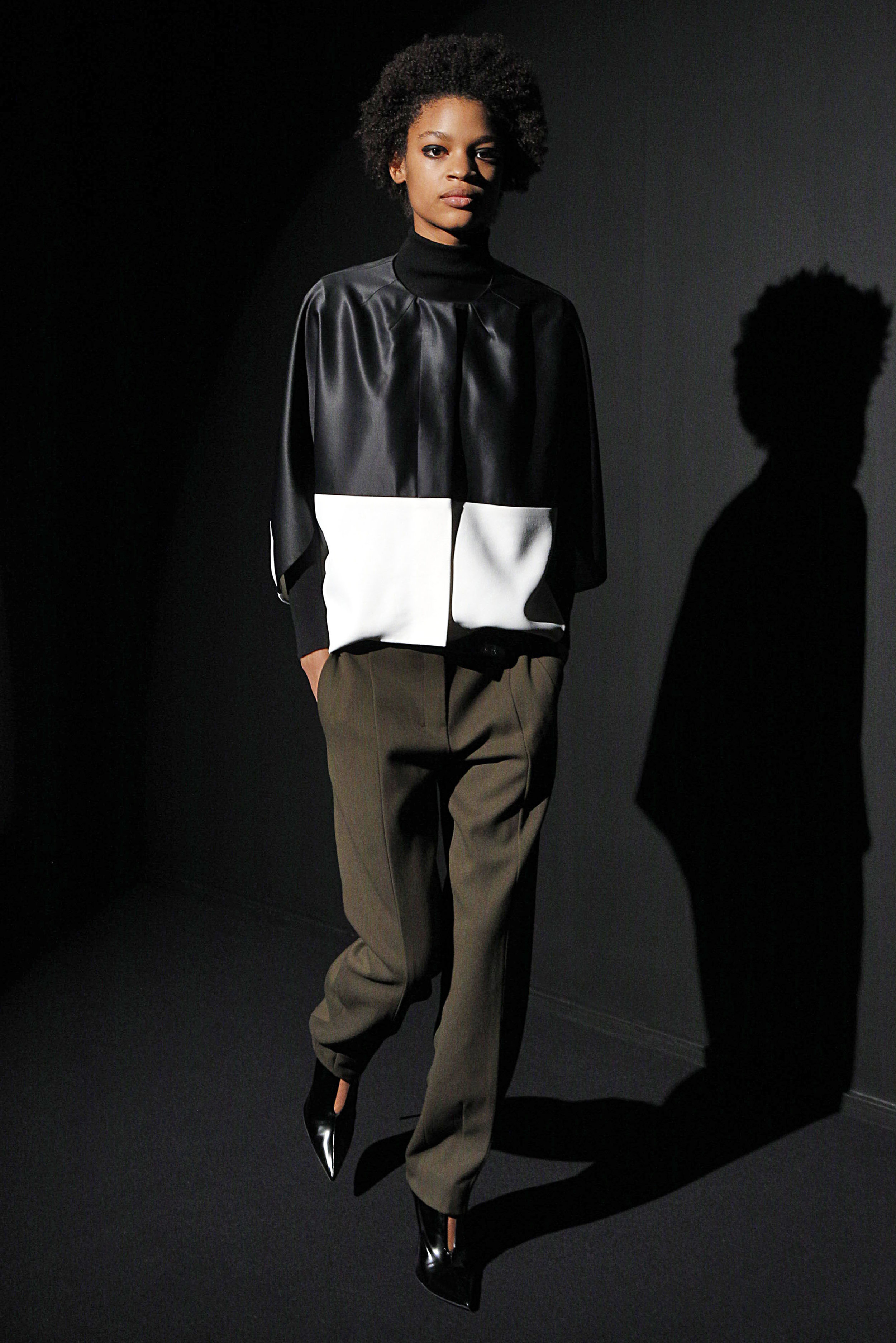 Look 1 Black satin/white crepe top over black knit turtleneck top with moss wool barathea pant.