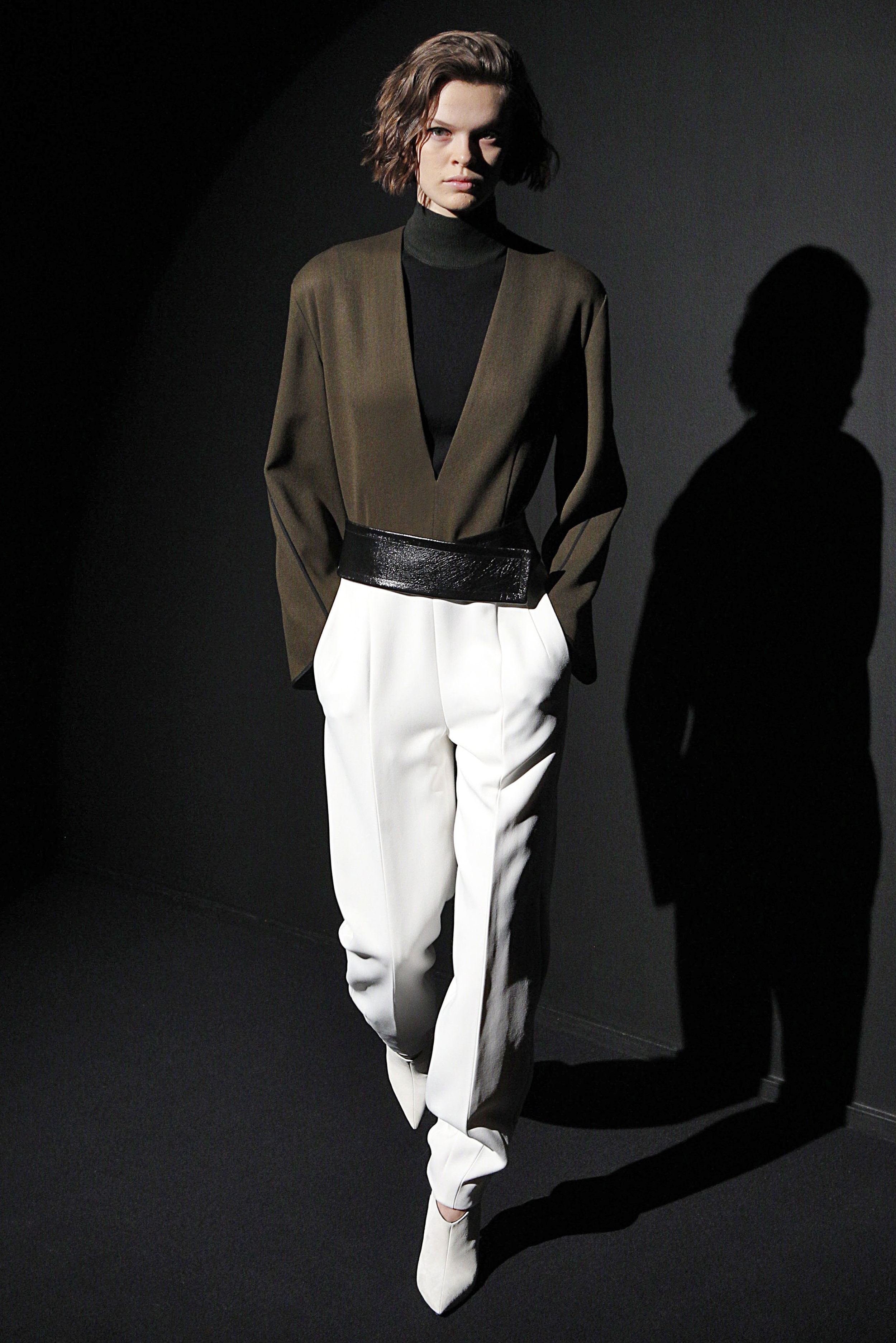 Look 3 Moss wool/white crepe jumpsuit with black sleeveless turtleneck and black leather belt.