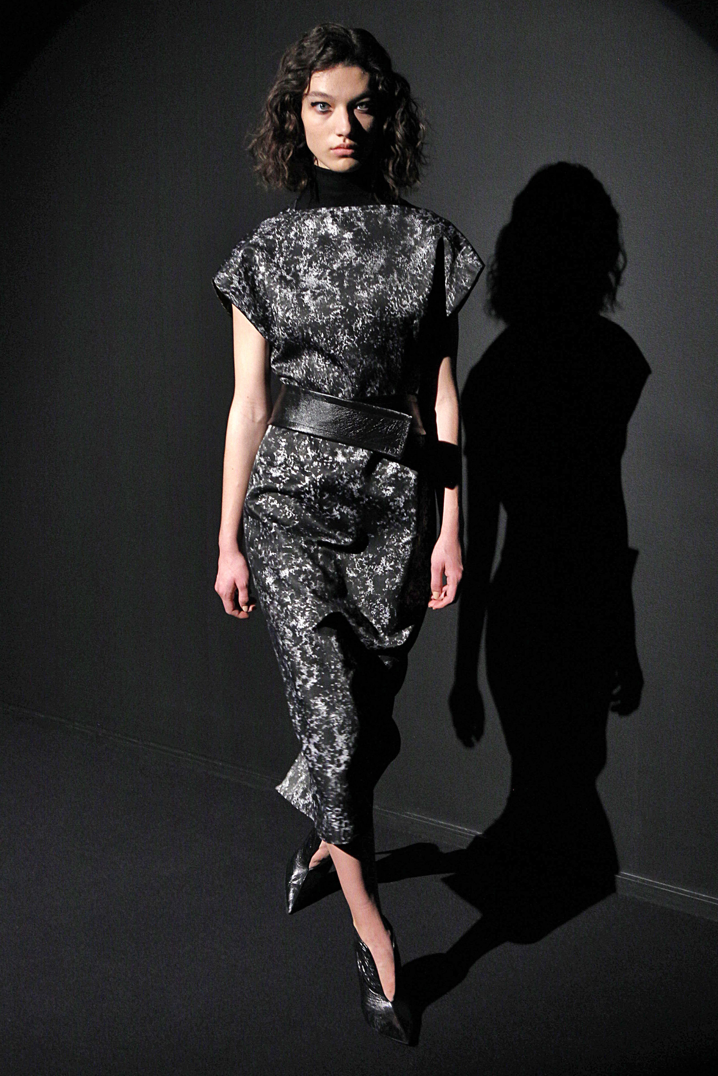 Look 4 Hand painted black/white silk dress with black sleeveless turtleneck and black leather belt.