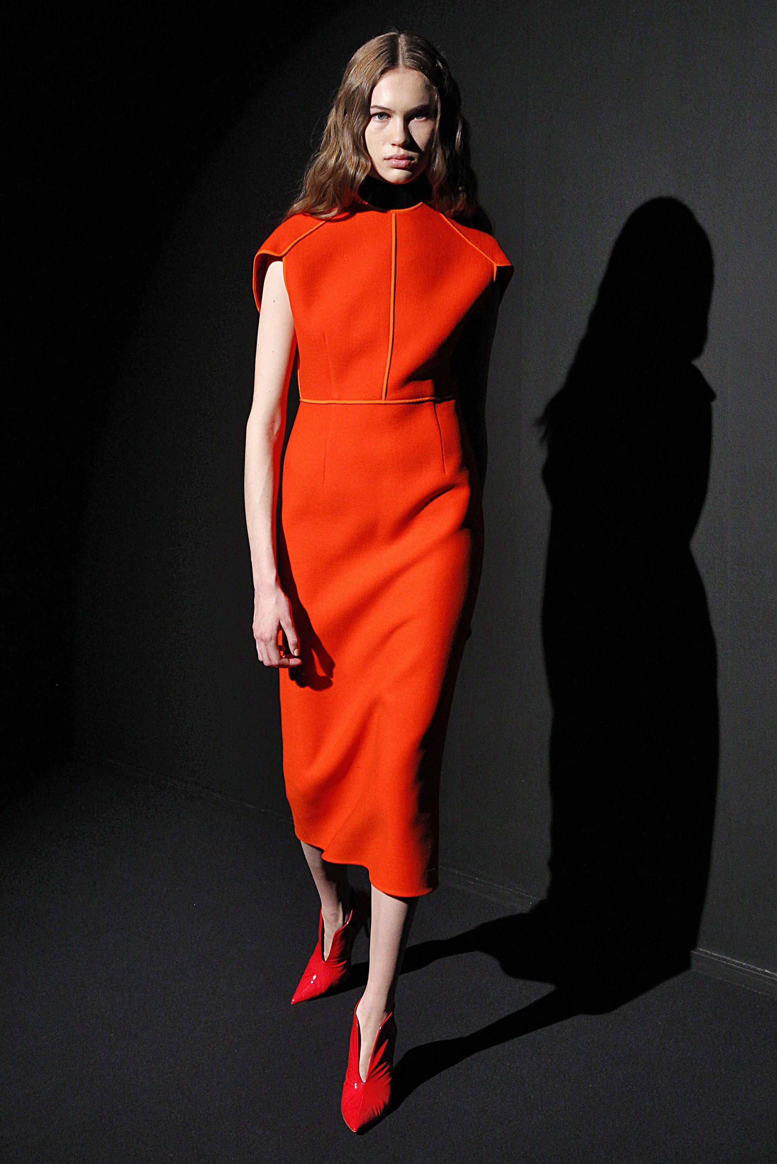 Look 8 Red wool dress over black sleeveless turtleneck.