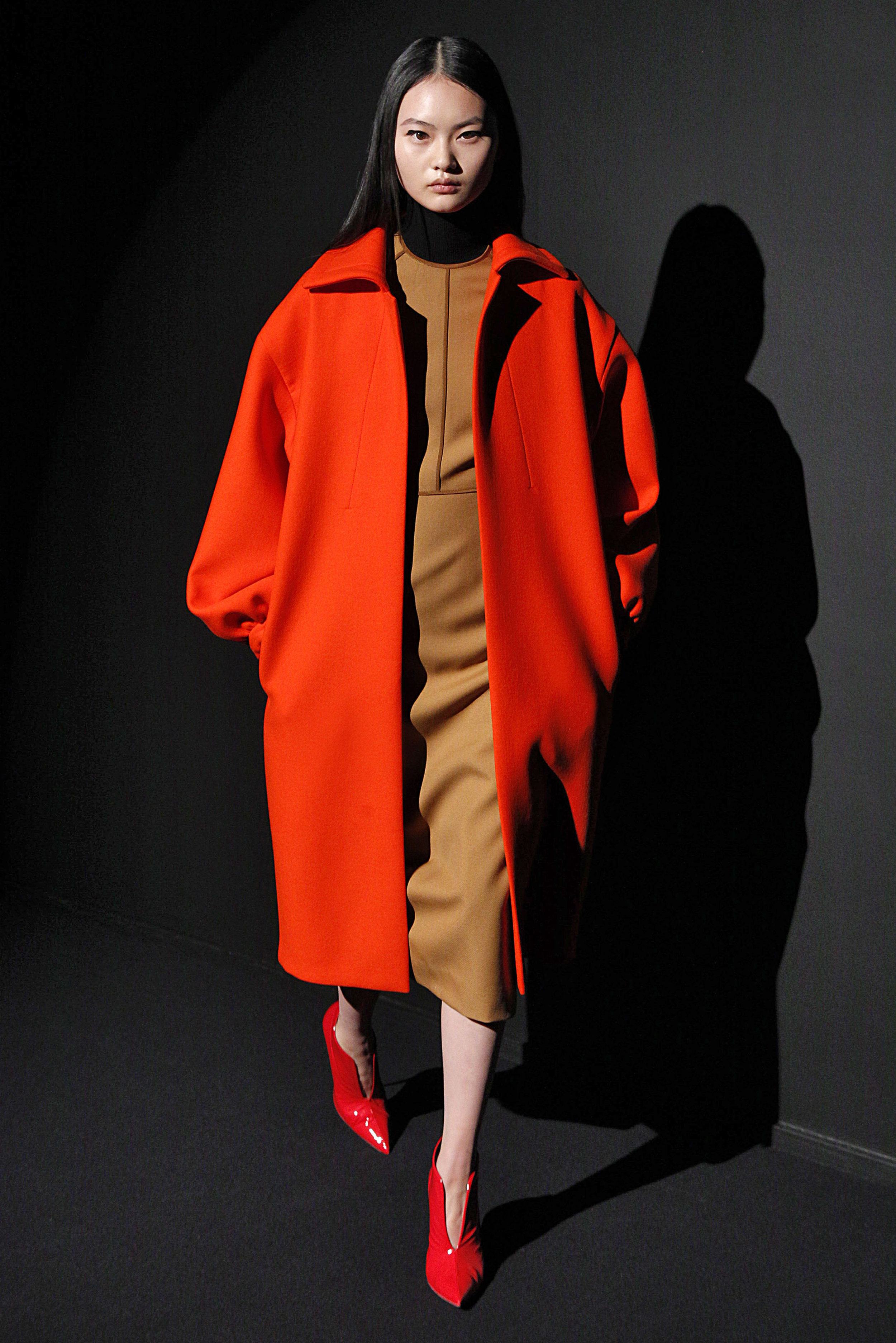 Look 7 Red wool coat over black/white sleeveless turtleneck with bronze wool twill dress.