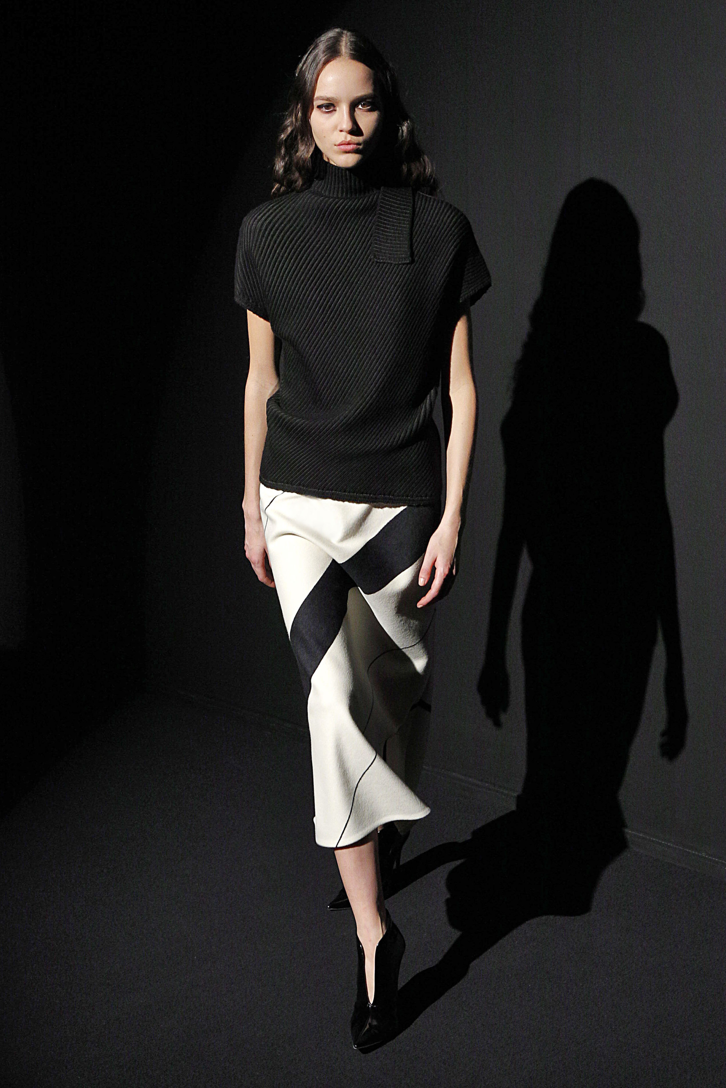 Look 11 Moss/black sweater with white/black stripe wool skirt.