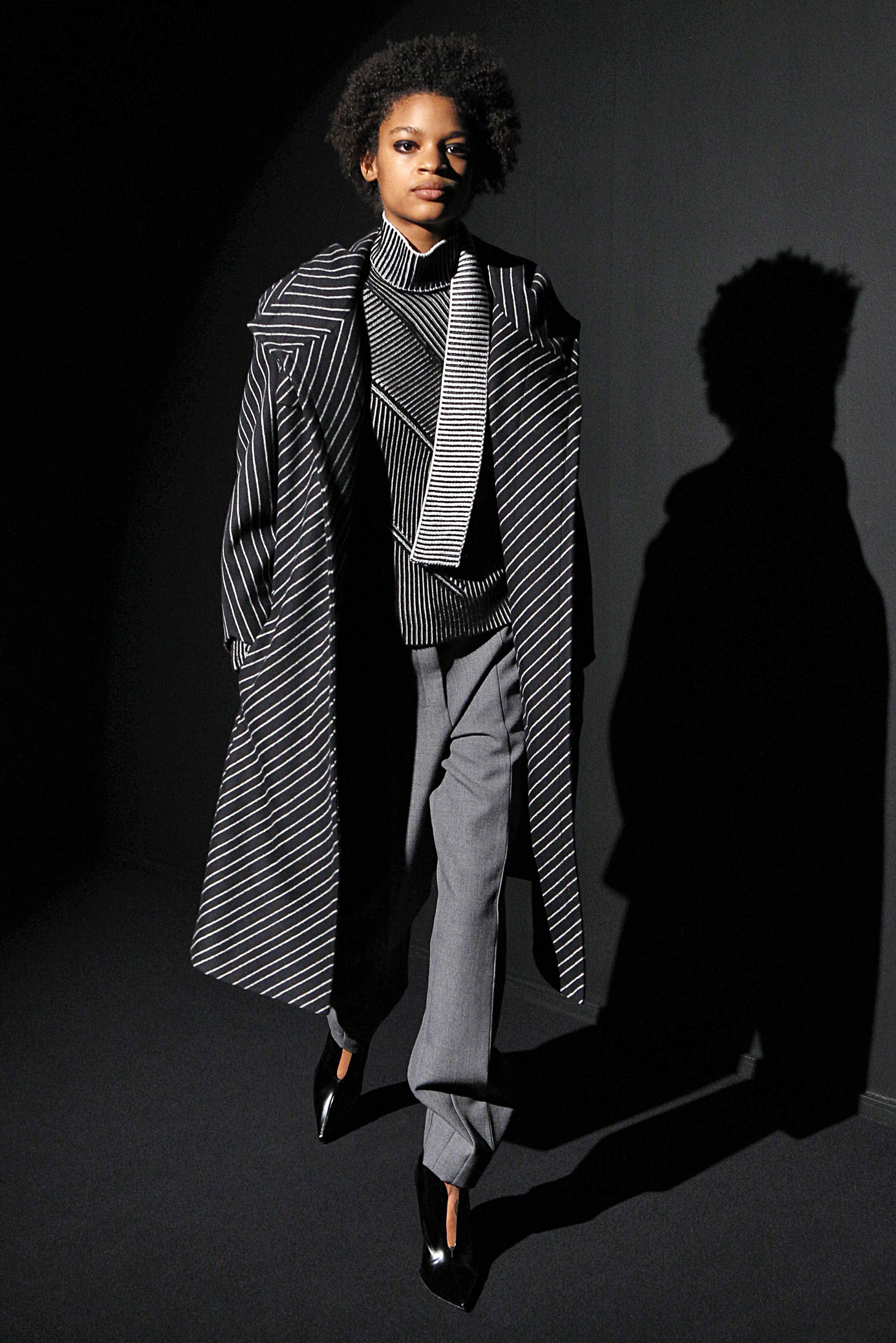 Look 10 Black/white striped wool coat over black/white knit top with grey wool twill pant.