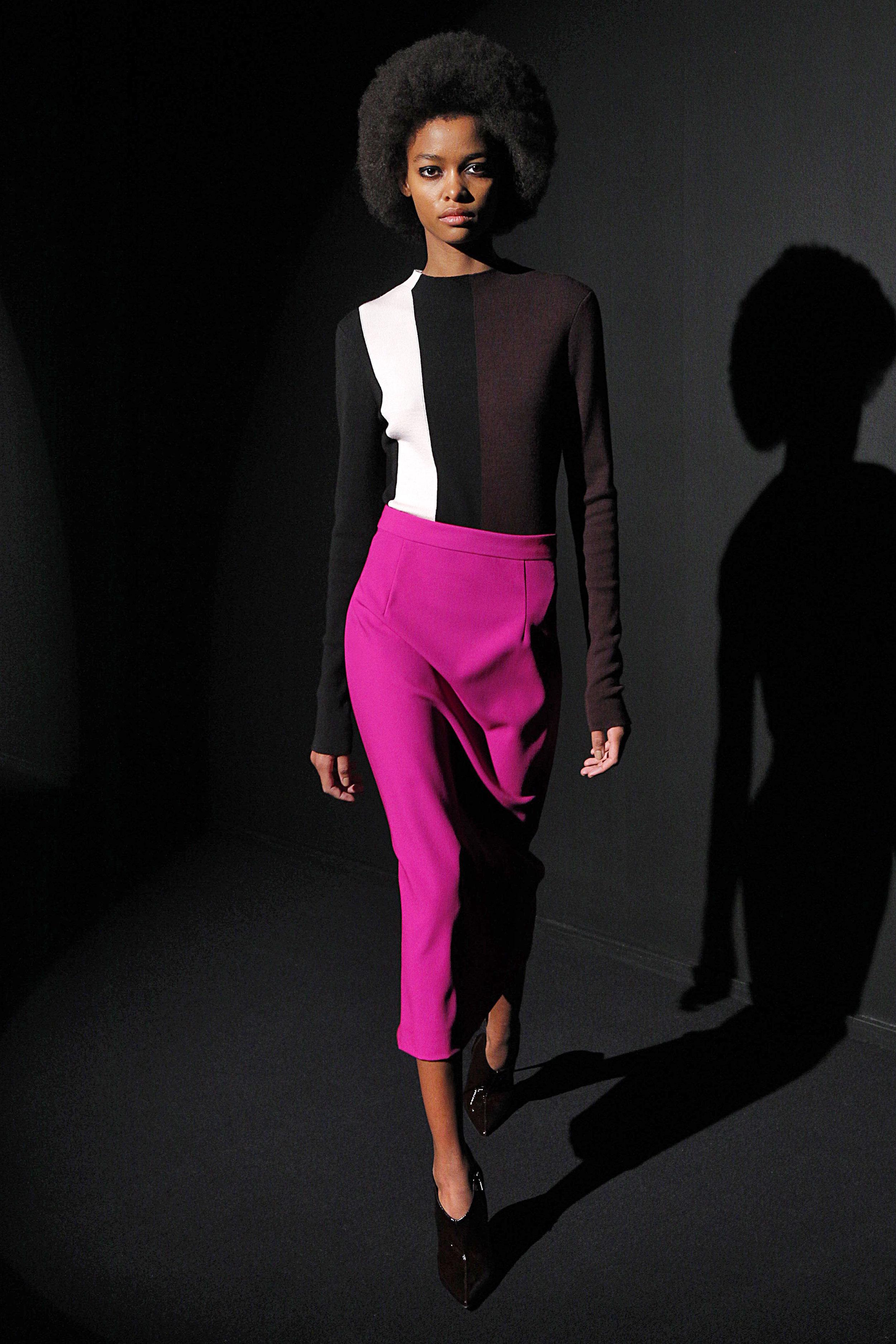 Look 12 Burgundy/black/pink long sleeve turtleneck with fuchsia wool barathea skirt.