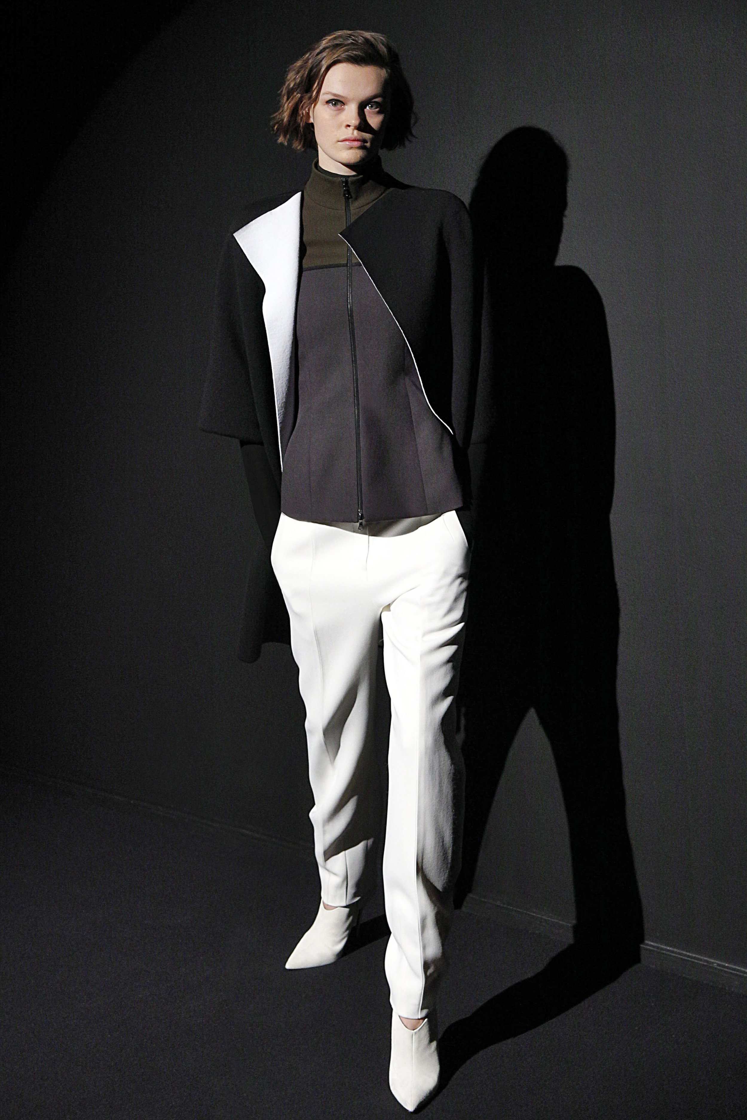 Look 13 Black/white knit coat over moss/charcoal wool jacket with white pant.