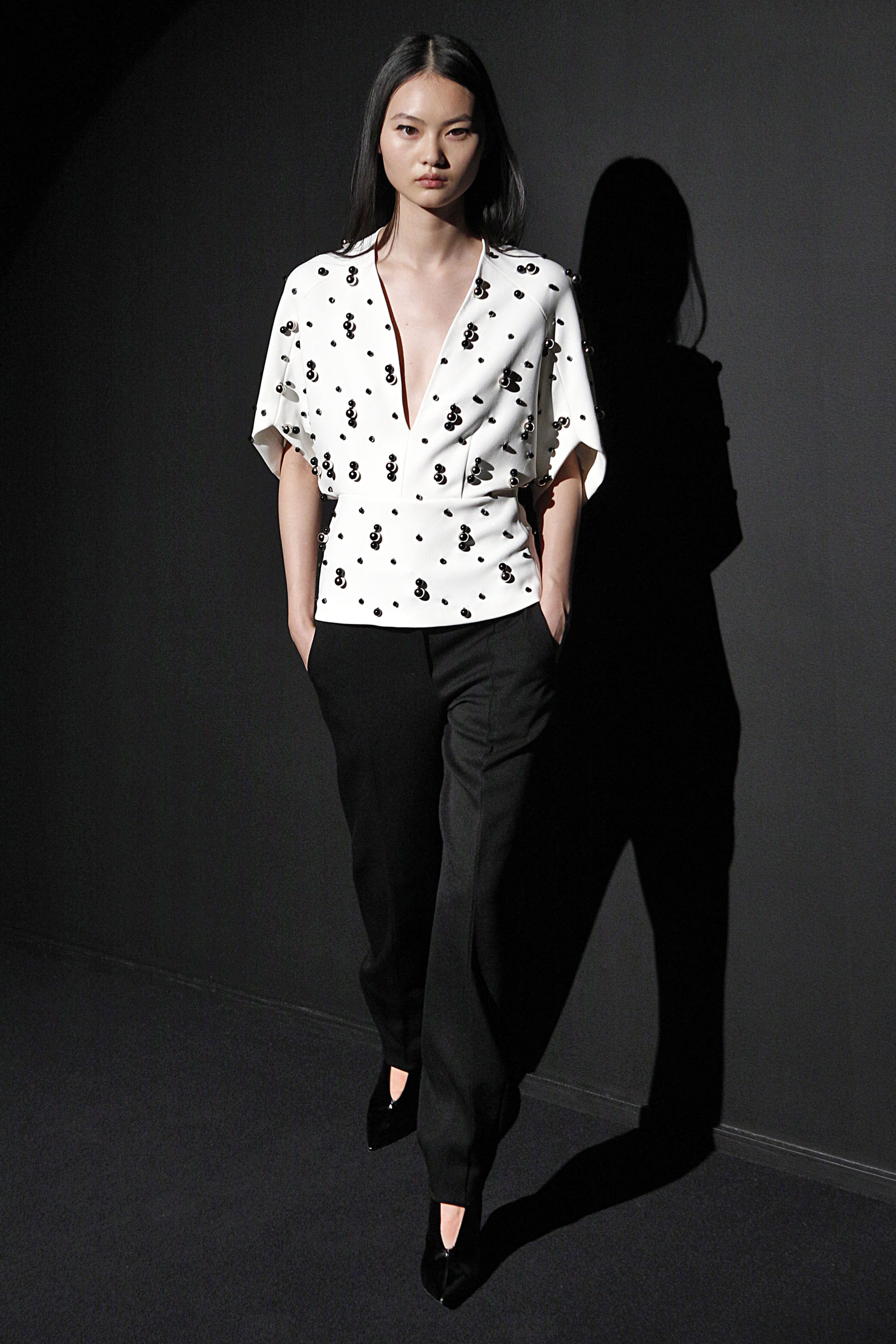 Look 16 White crepe embroidered top with black wool barathea pant.