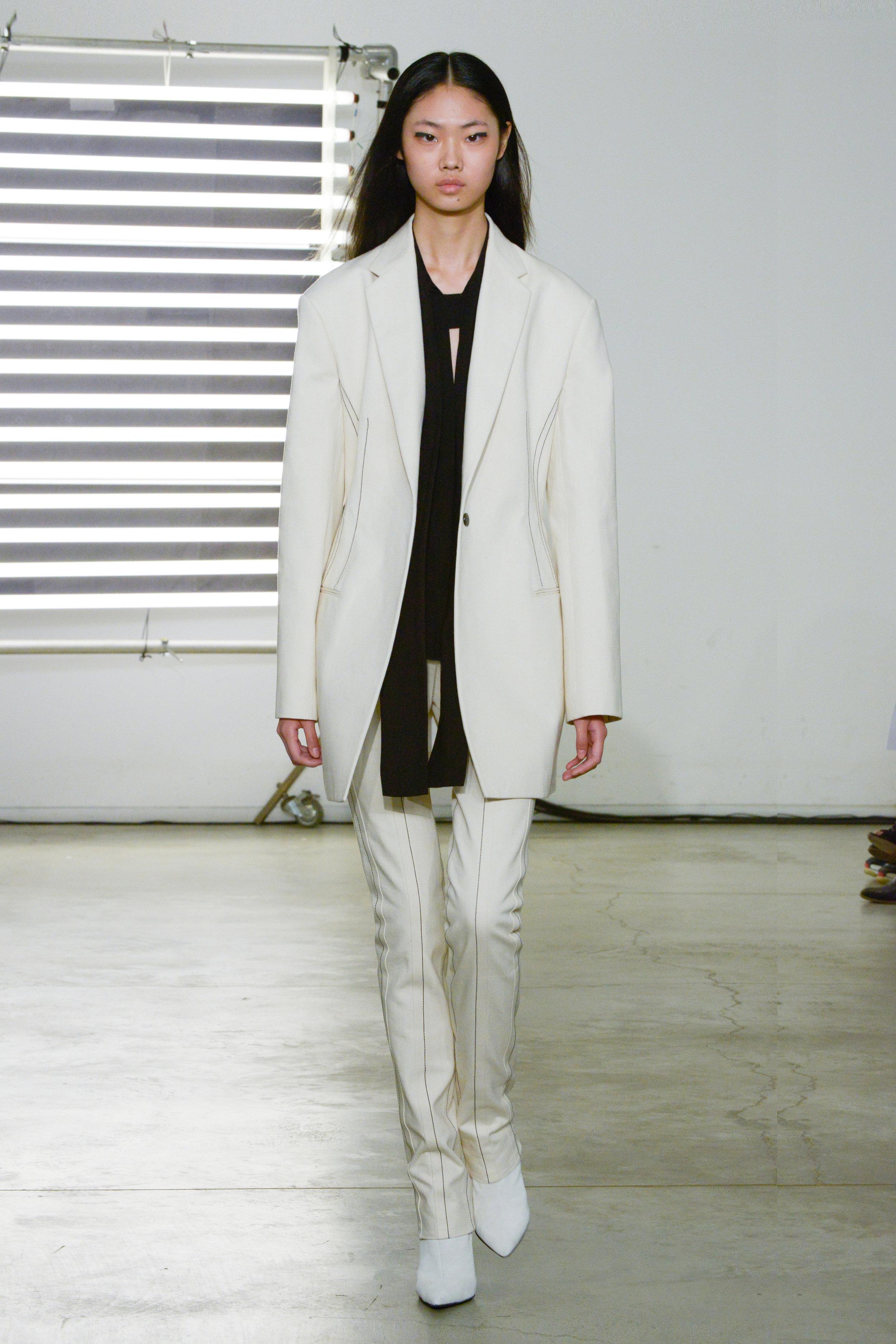 Look 3 Natural denim jacket over black crepe top with natural denim pant.