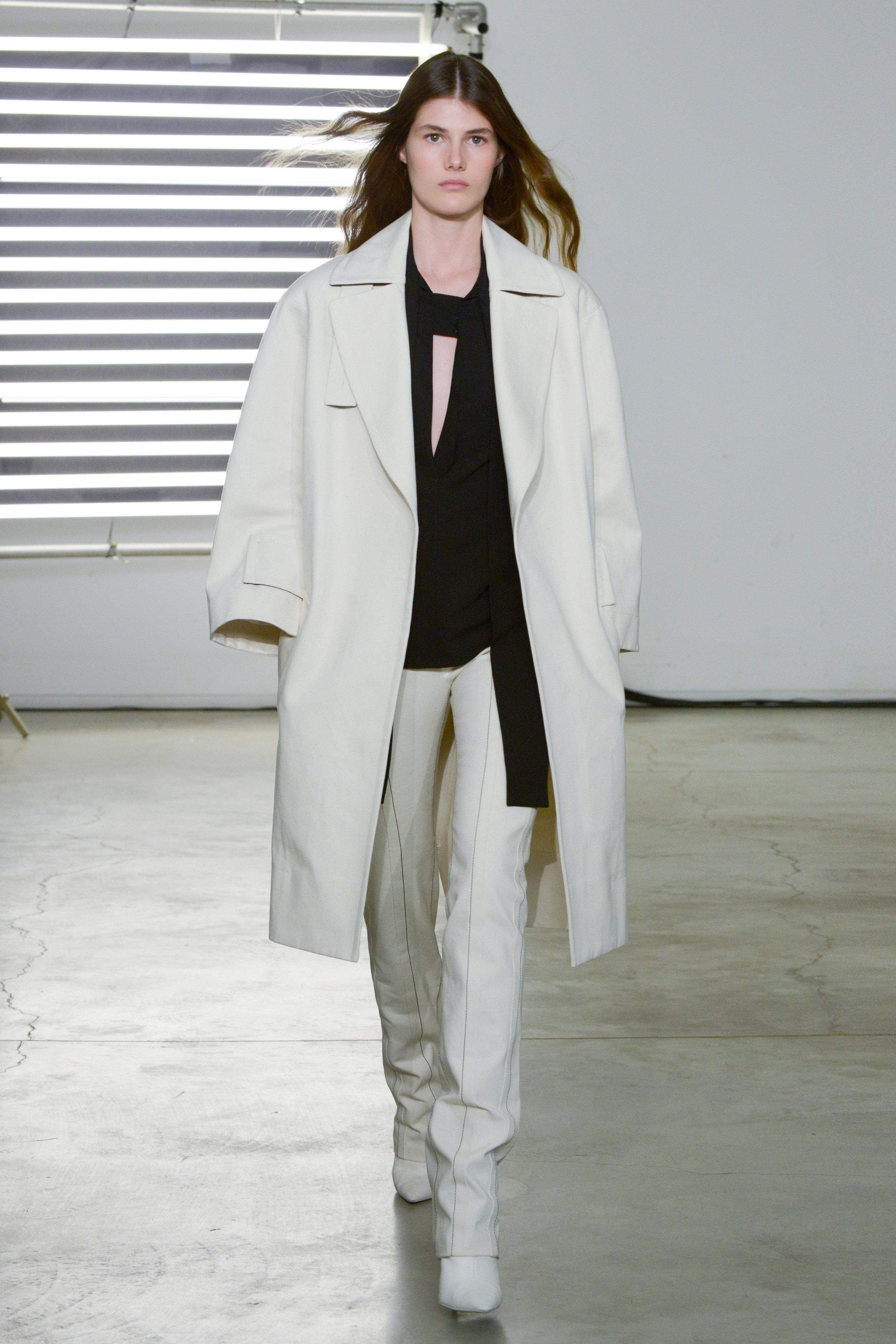 Look 1 Natural denim coat over black crepe top with natural denim pant.