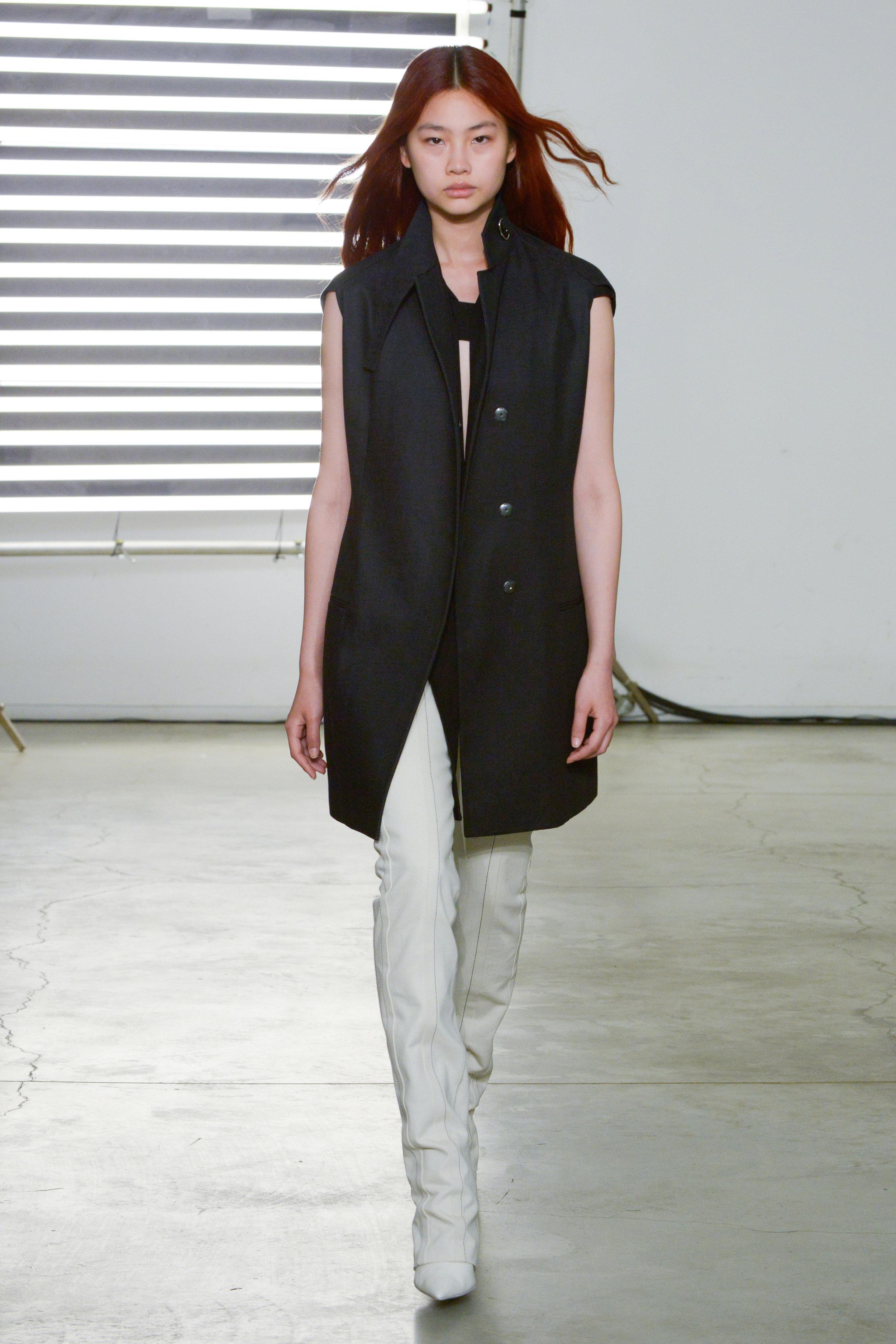 Look 5 Grey/black denim sleeveless jacket over black crepe top with natural denim pant.