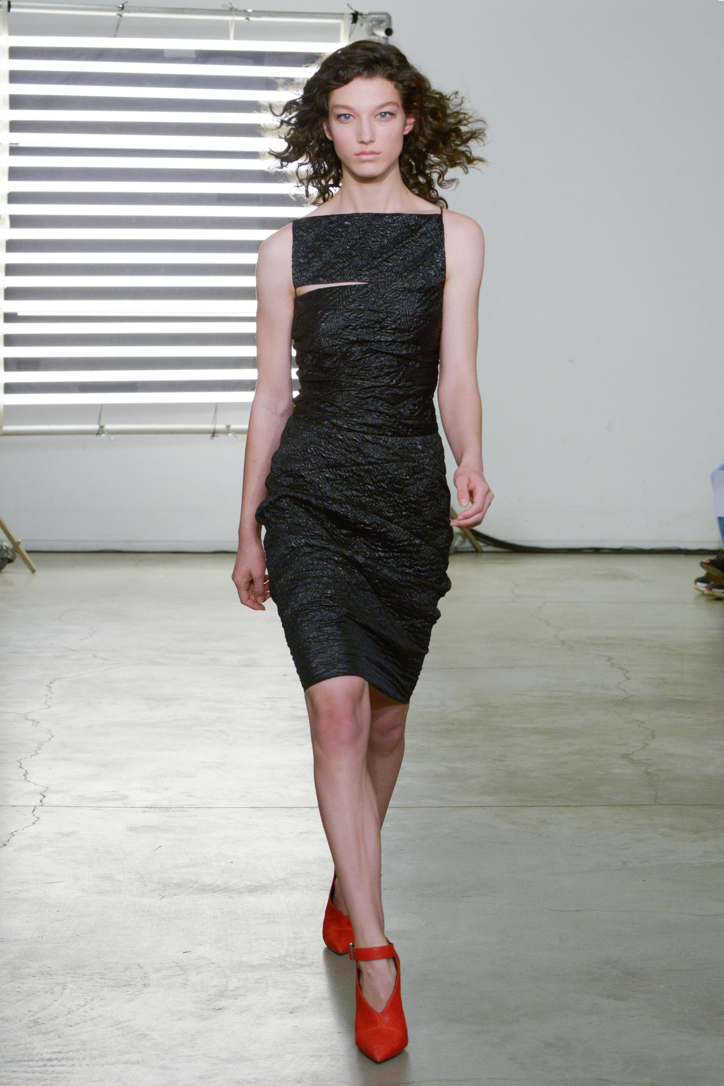 Look 6 Black cloque dress.