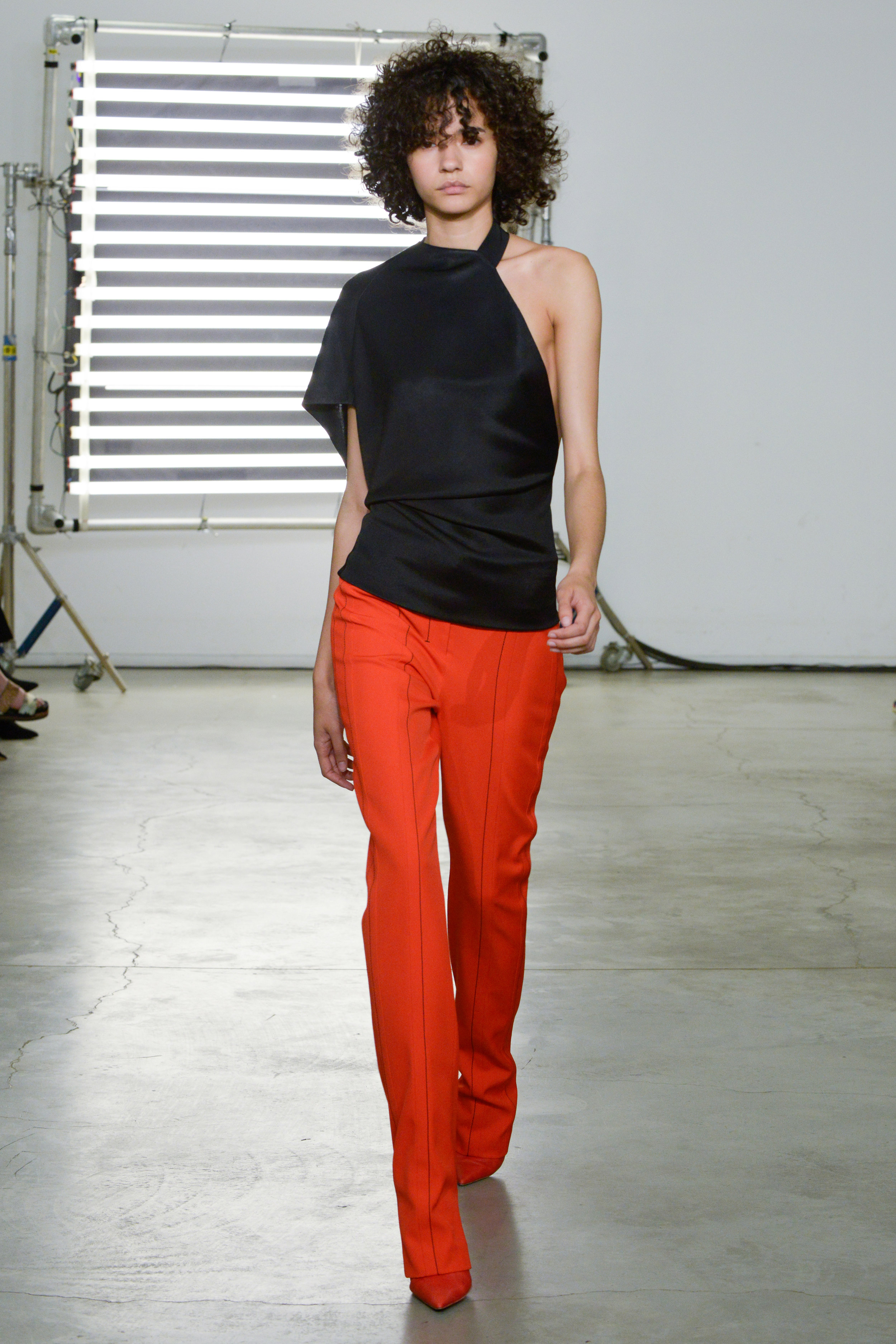 Look 8 Black jersey top with red wool twill pant.