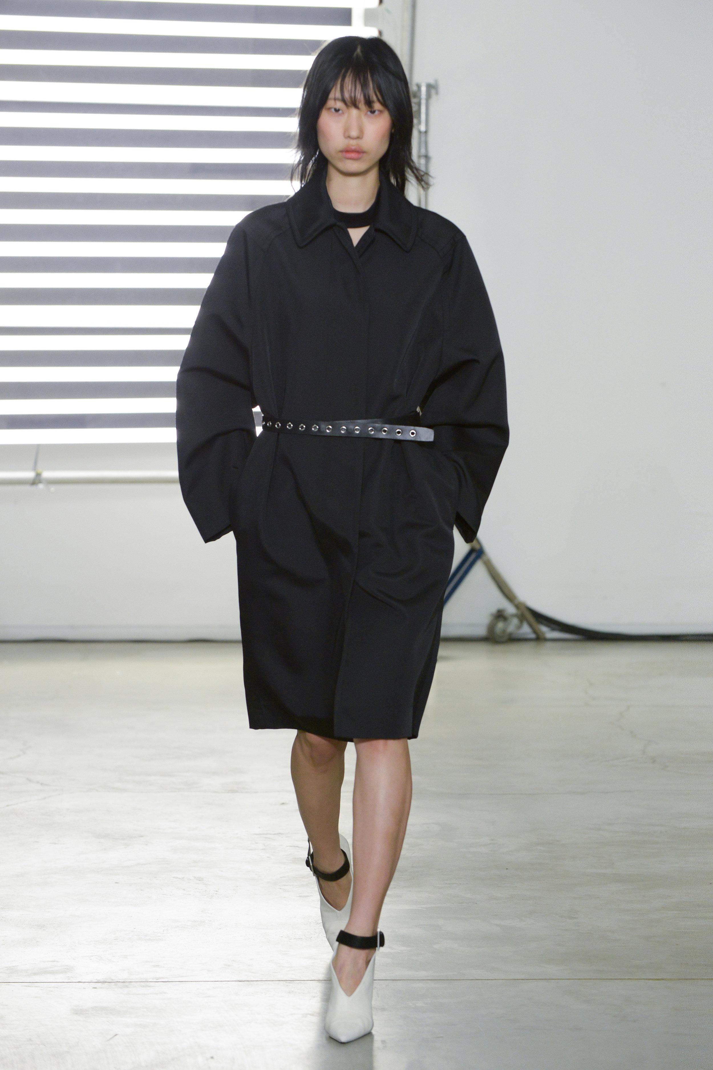 Look 9 Black wool/nylon canvas coat with black leather belt.