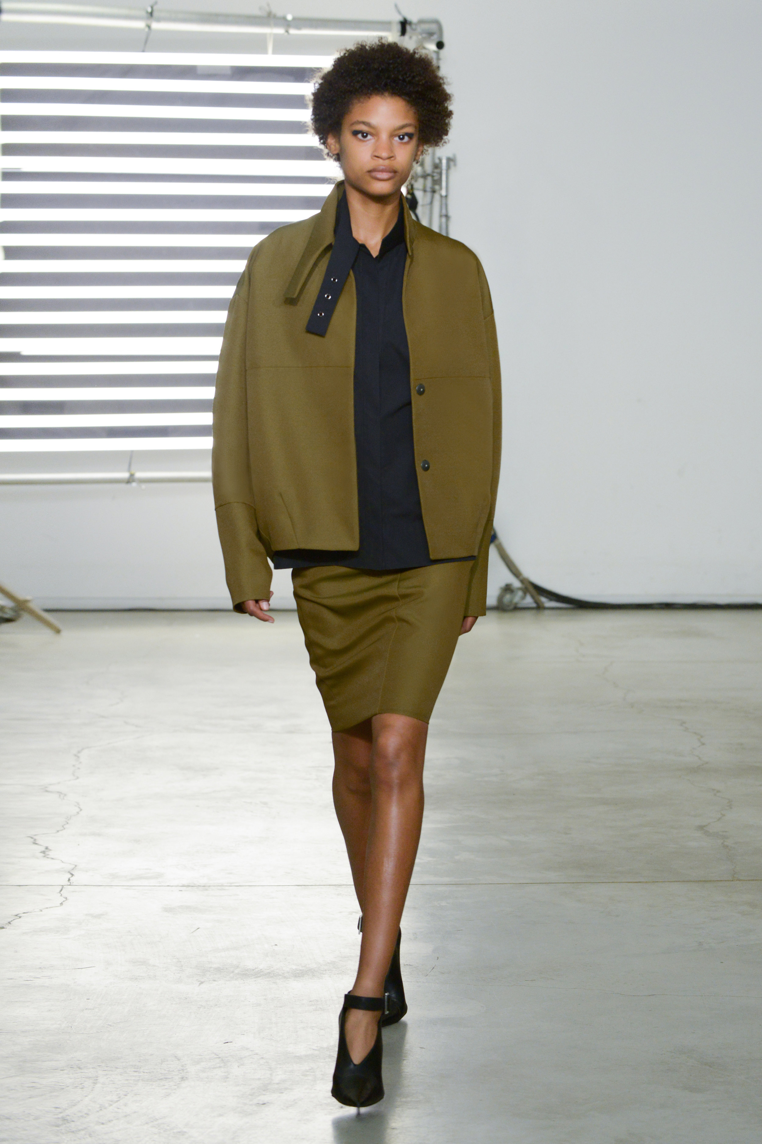 Look 14 Green wool/nylon canvas skirt suit with black polished cotton top.