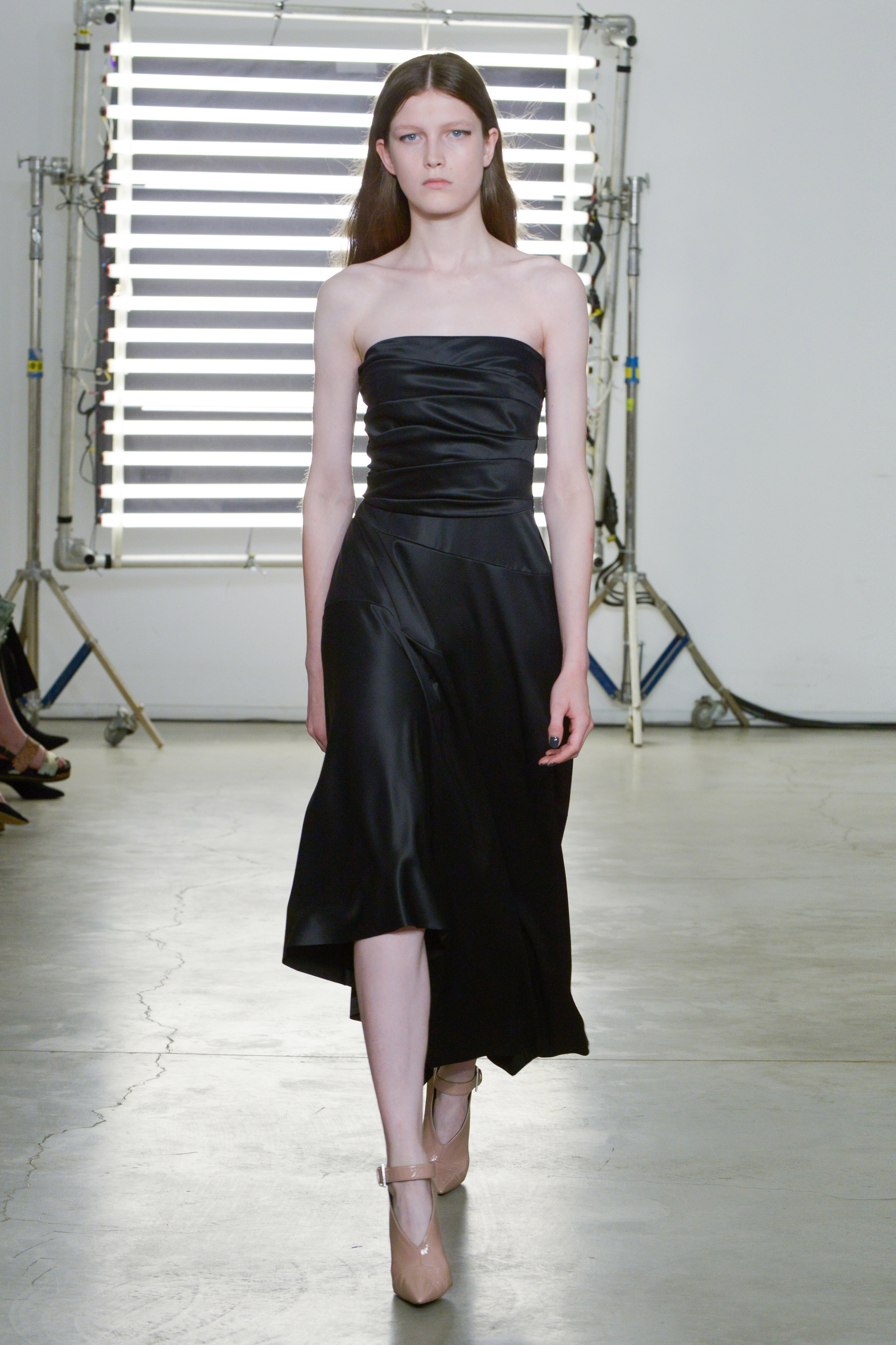 Look 18 Black satin strapless dress.