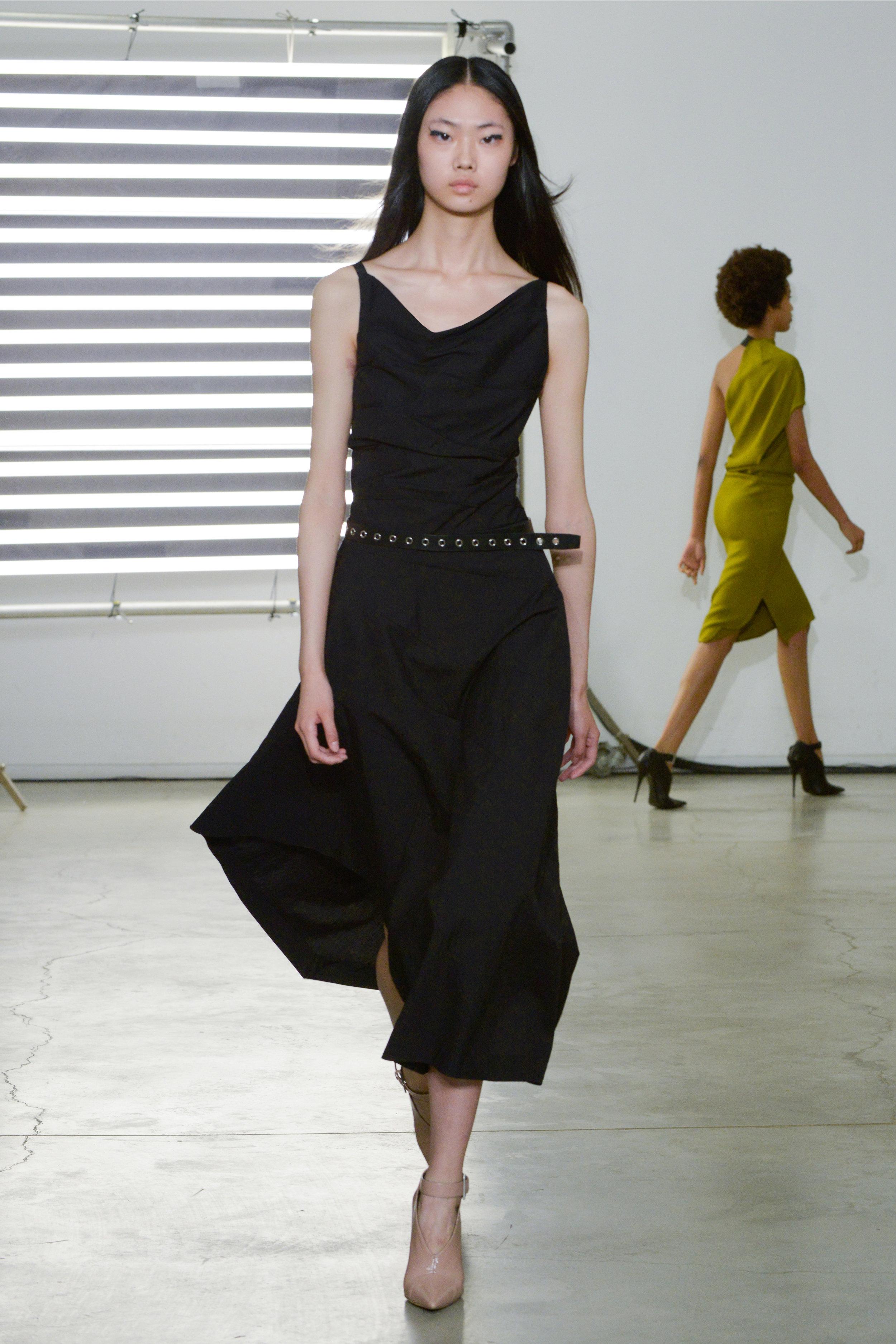 Look 17 Black textured cotton/nylon dress with black leather belt.