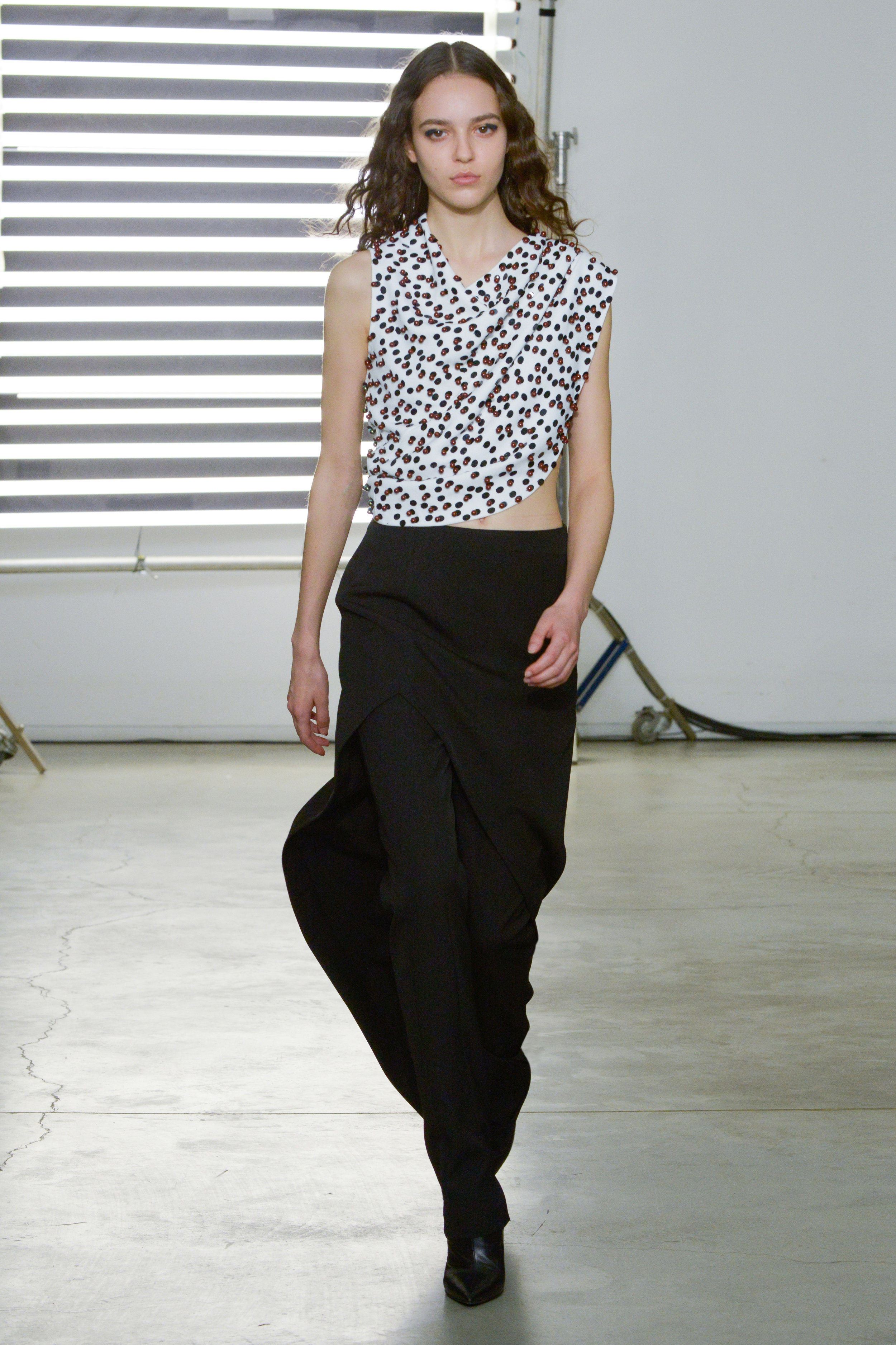 Look 19 Swarovski embroidered white top with black wool twill pant and black wool twill skirt.