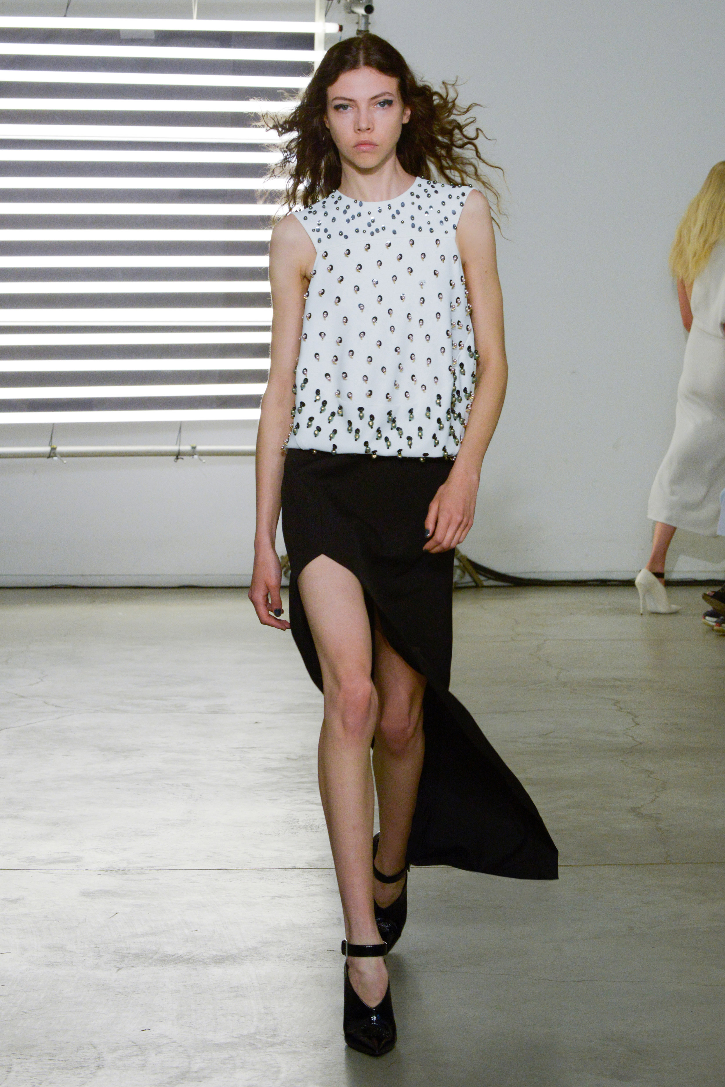 Look 21 Swarovski embroidered white bubble top with black wool twill skirt.