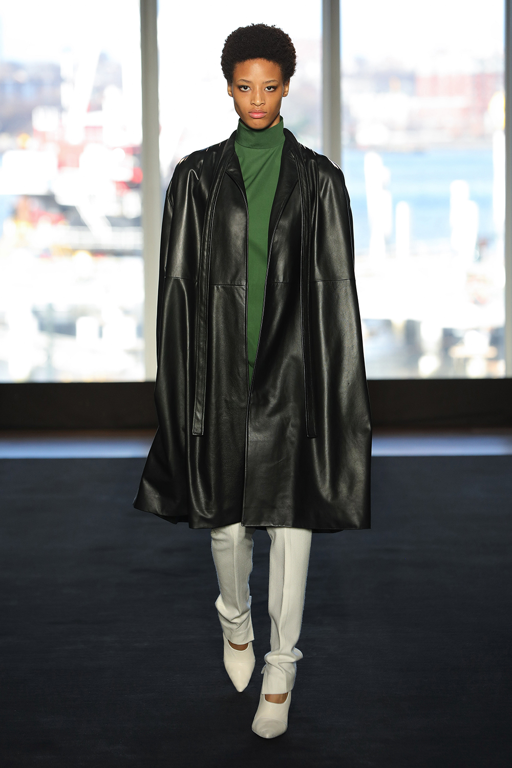 Look 4 Black leather coat over moss cotton tunic with white wool twill pant.