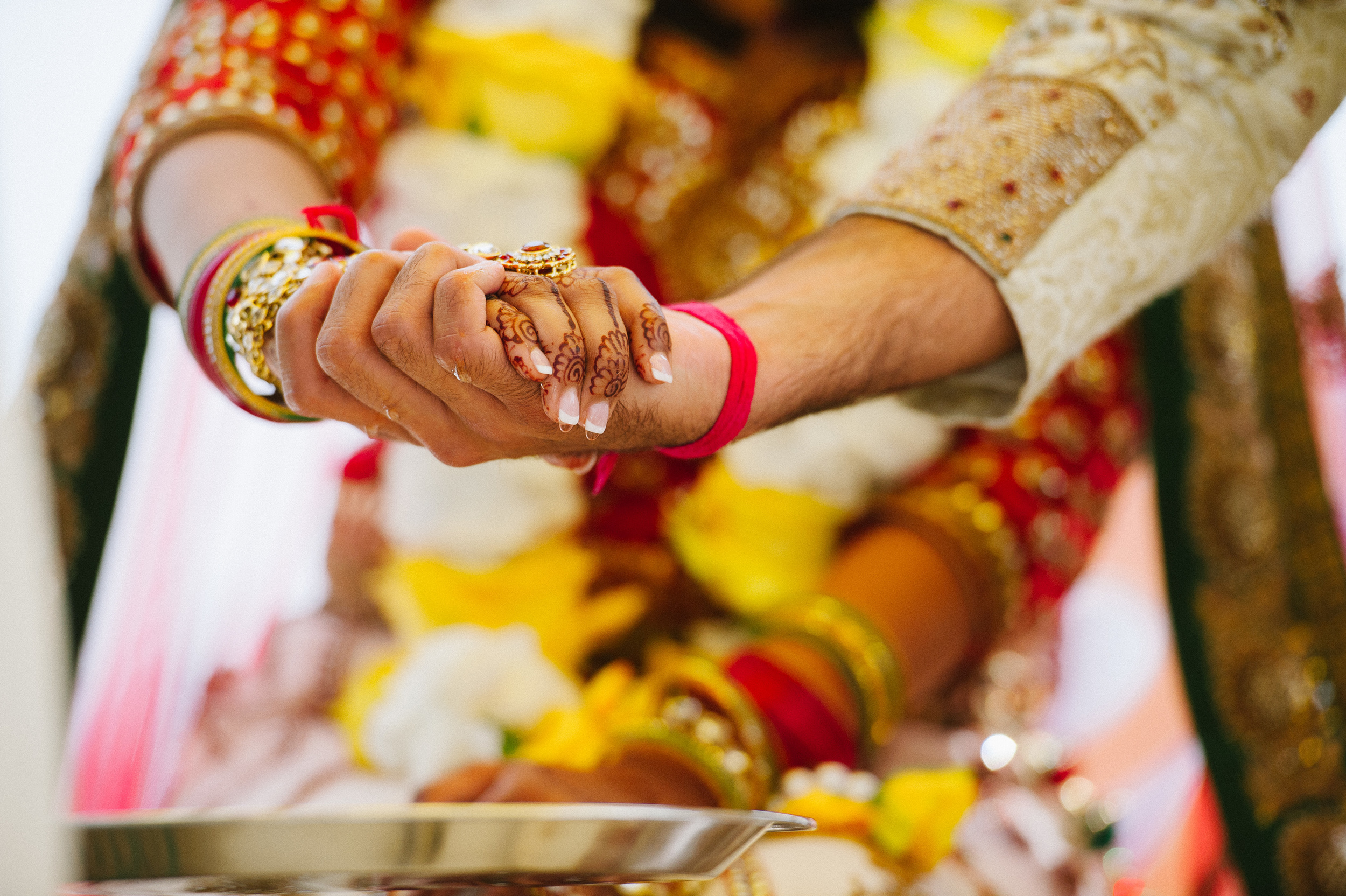 HOLDING HANDS AT HINDU CEREMONY