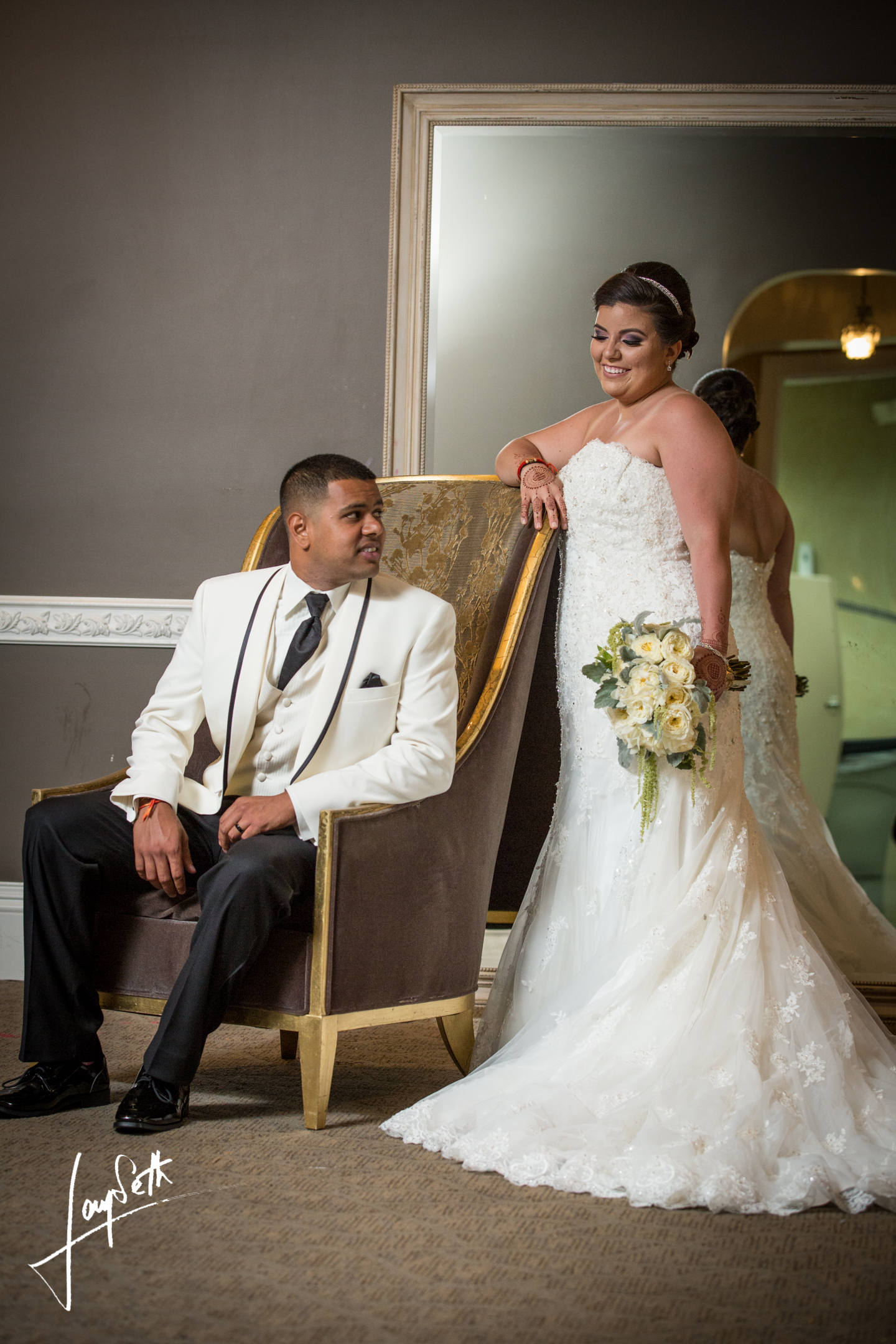 BRIDE AND SITTING GROOM