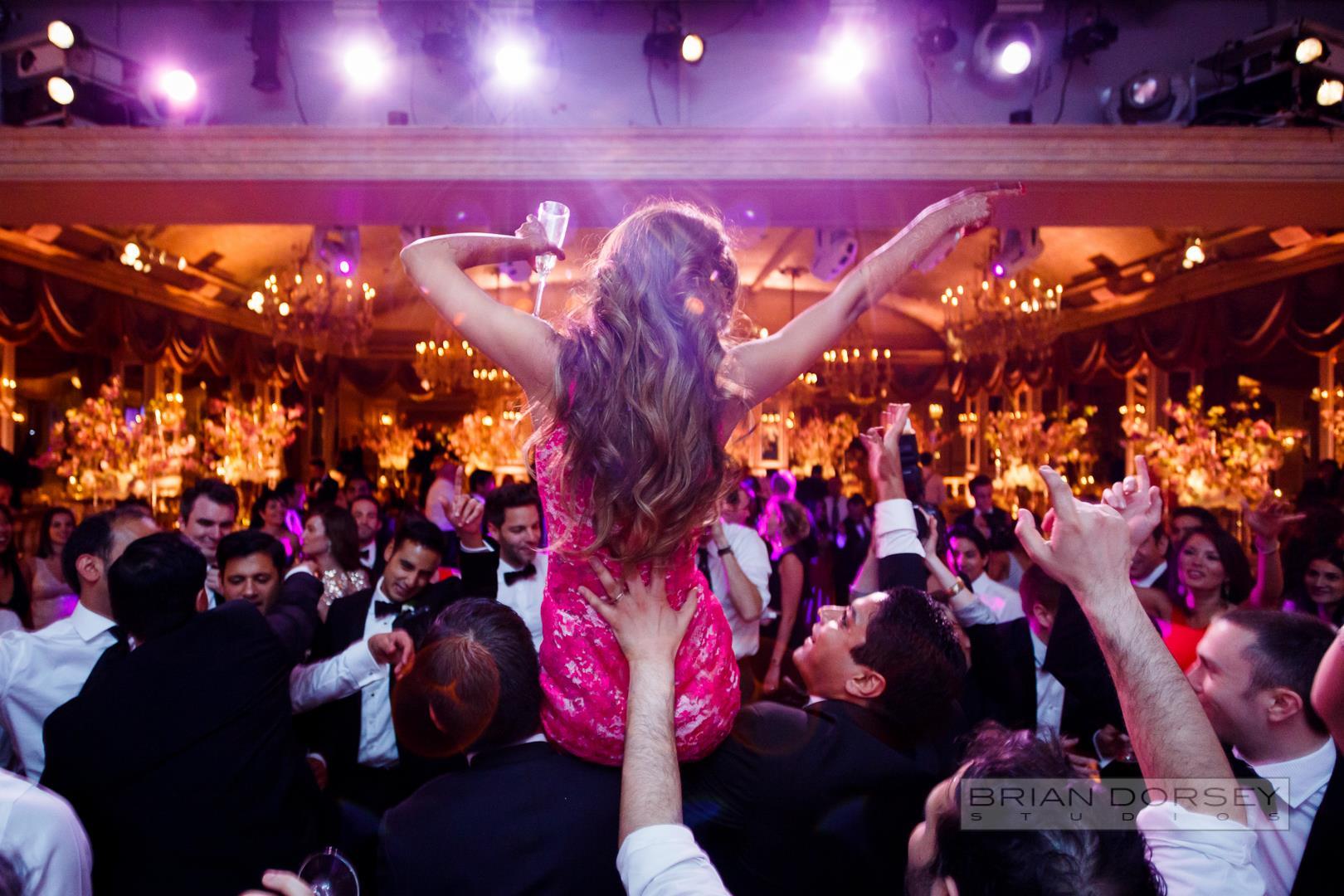 Indian bride dancing at wedding