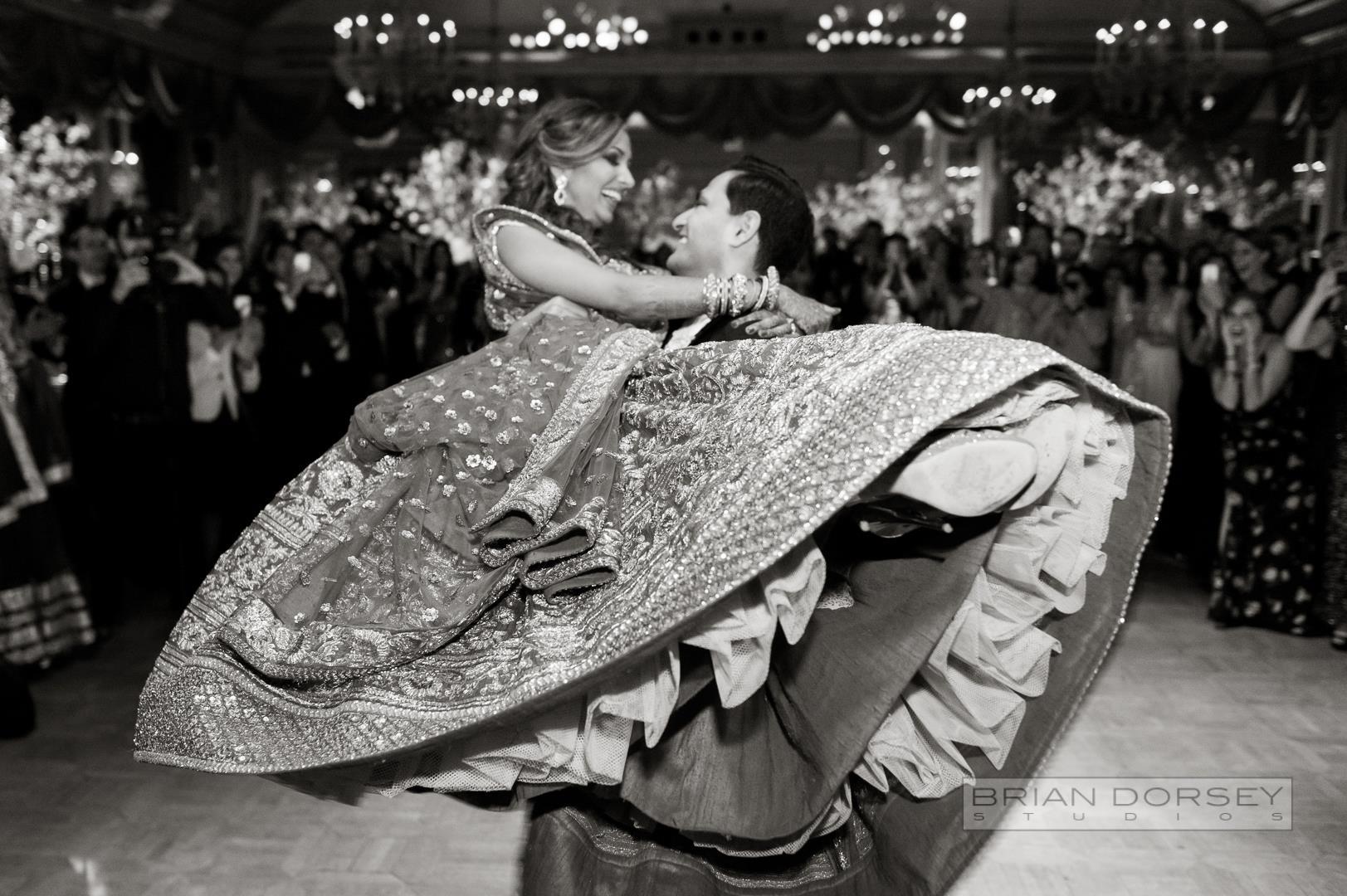 indian couple twirling on the dancefloor