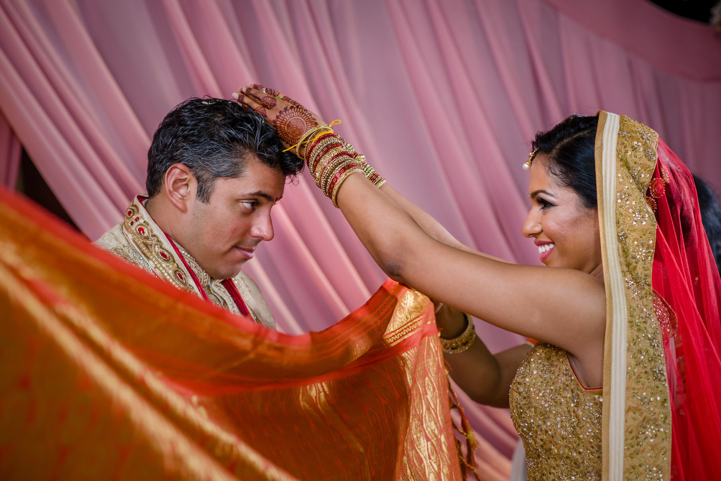 INDIAN BRIDE AND GROOM AT HINDU CEREMONY