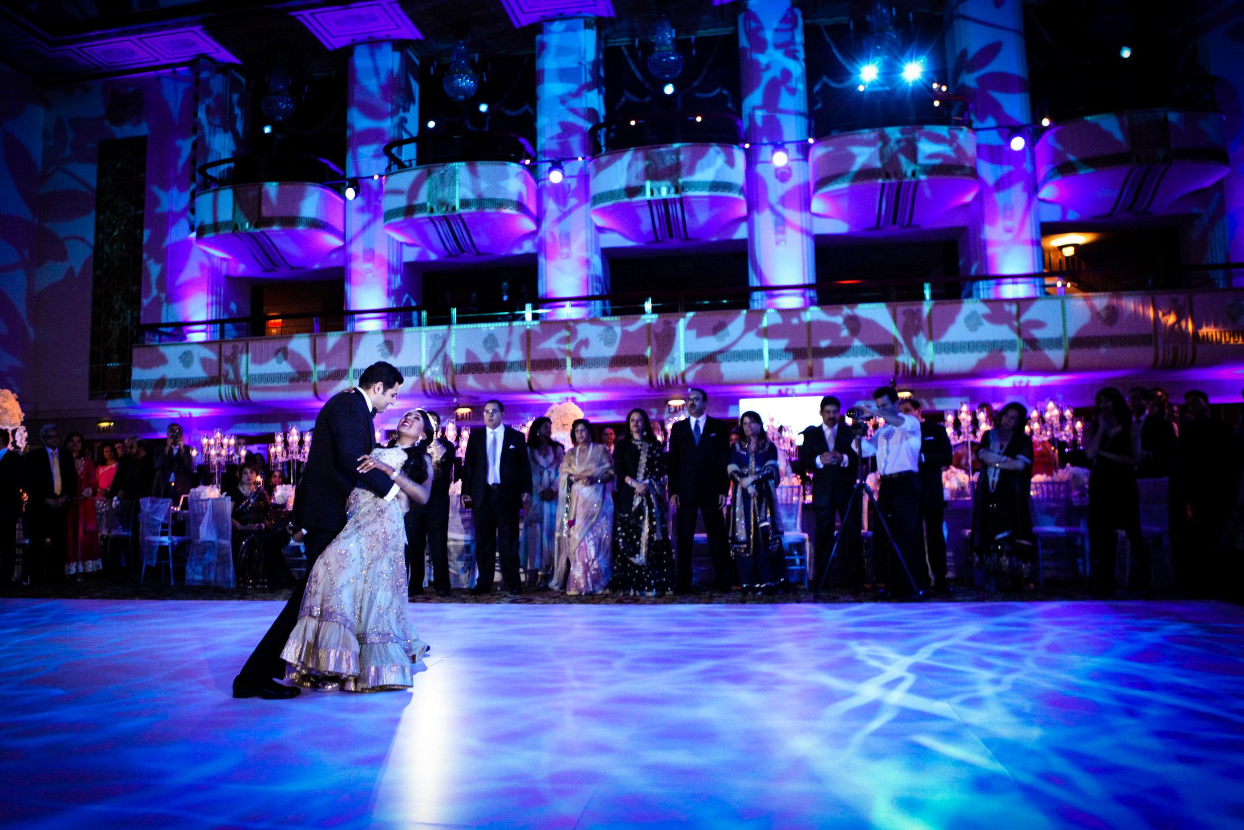Couple dipped on lit dancefloor