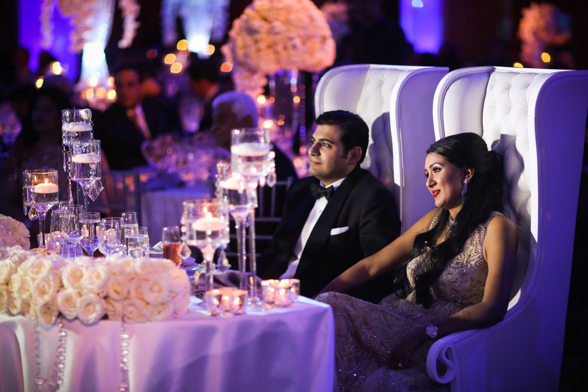 Indian couple on sweetheart sofa