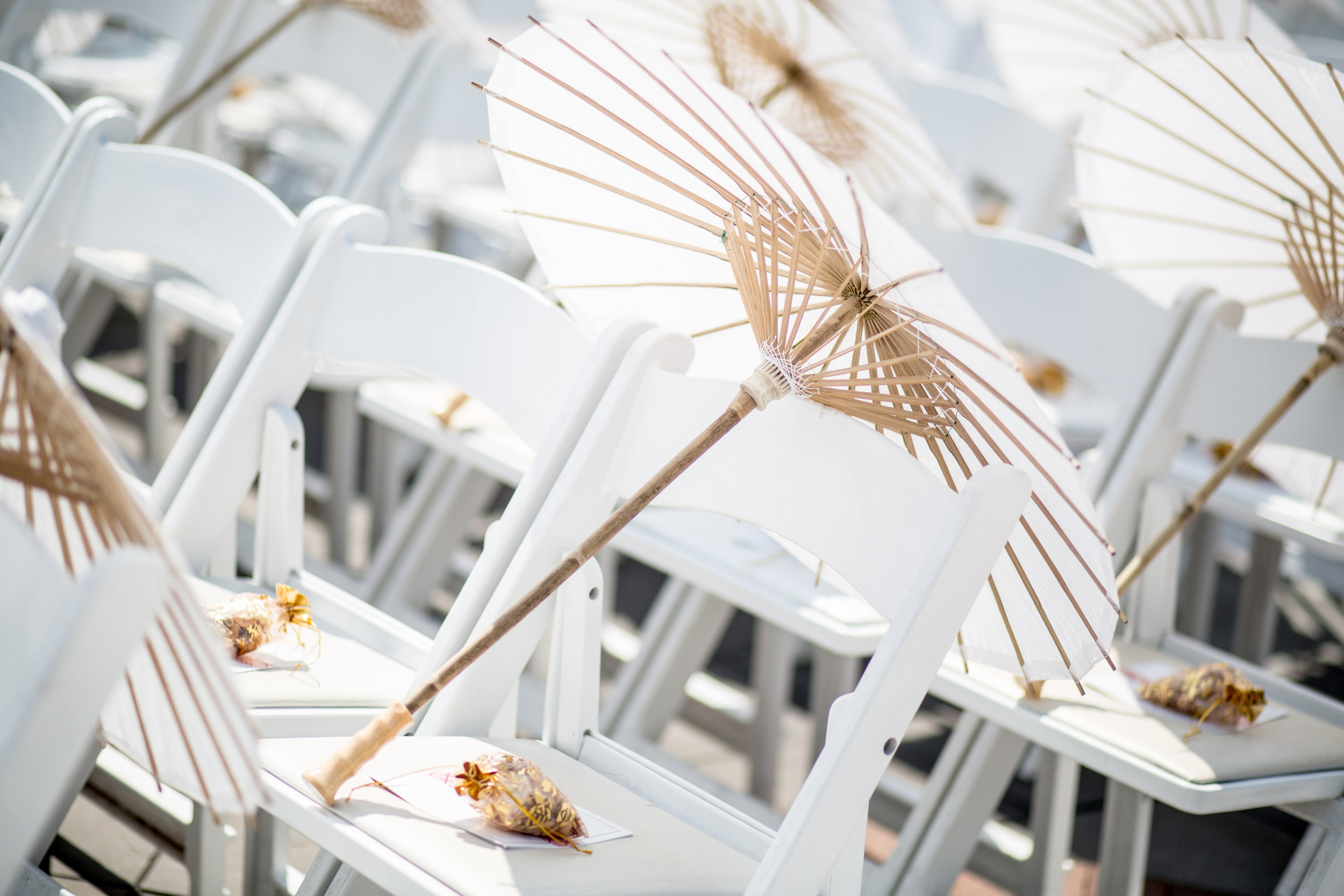 parasols on ceremony chairs