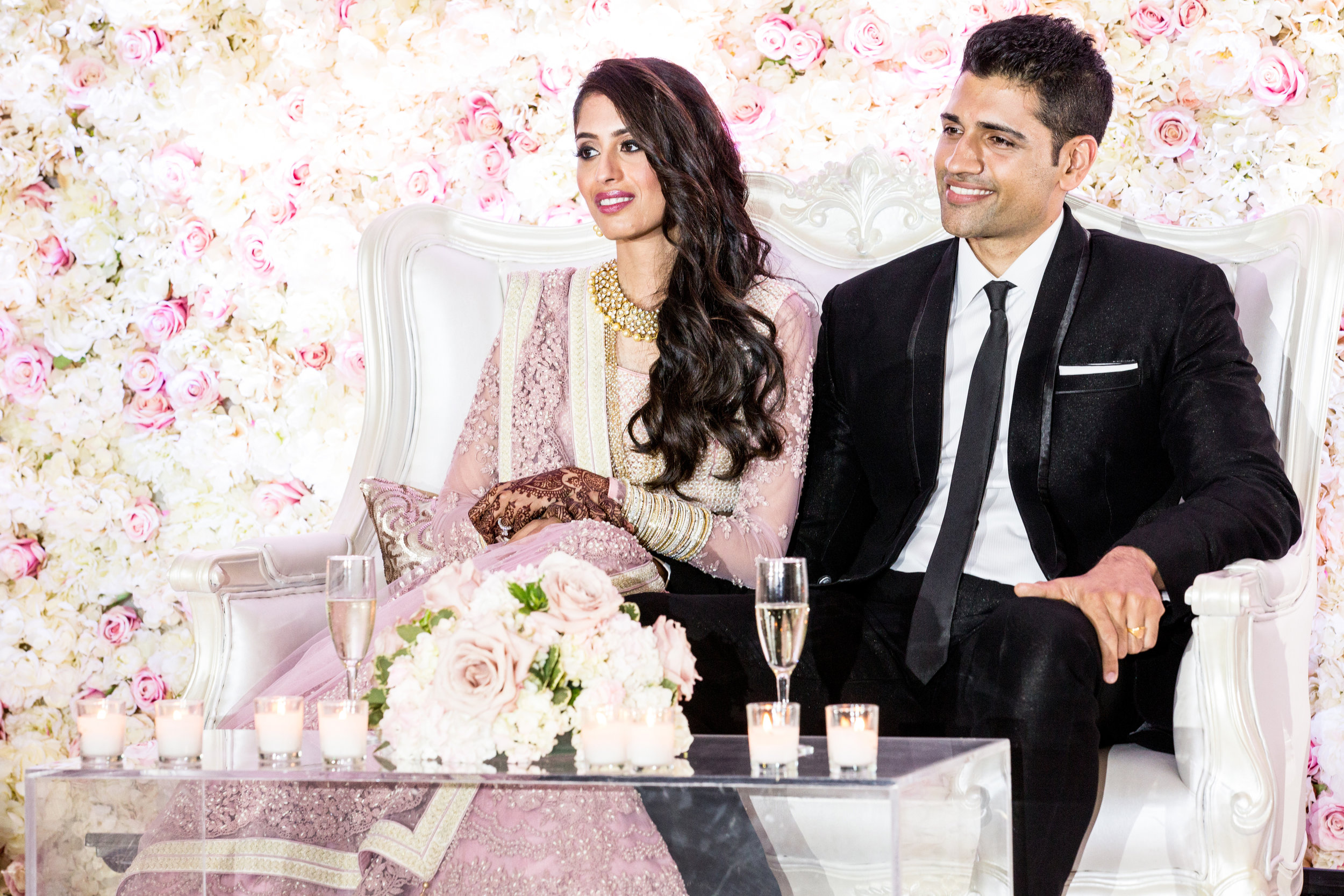 Beautiful couple with flower wall on sofa