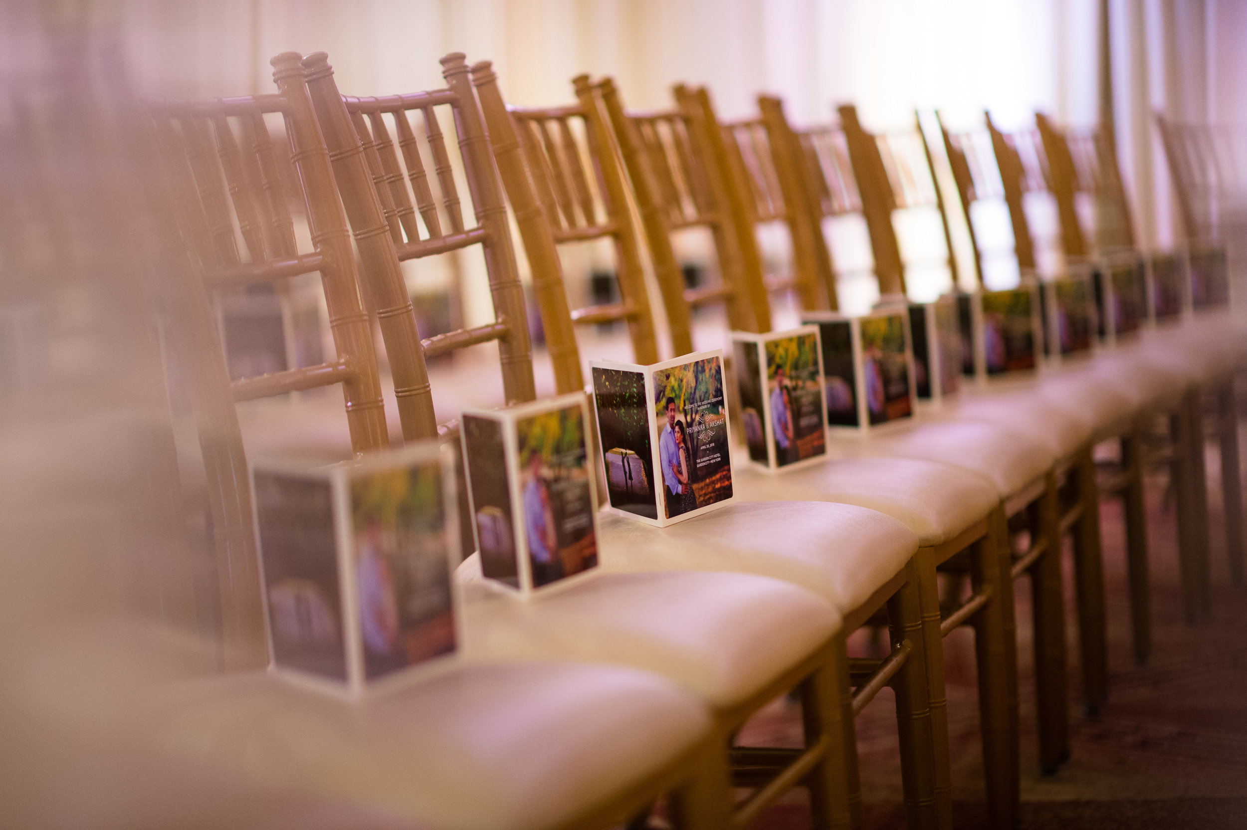 indian ceremony programs on chiavari chairs.JPG