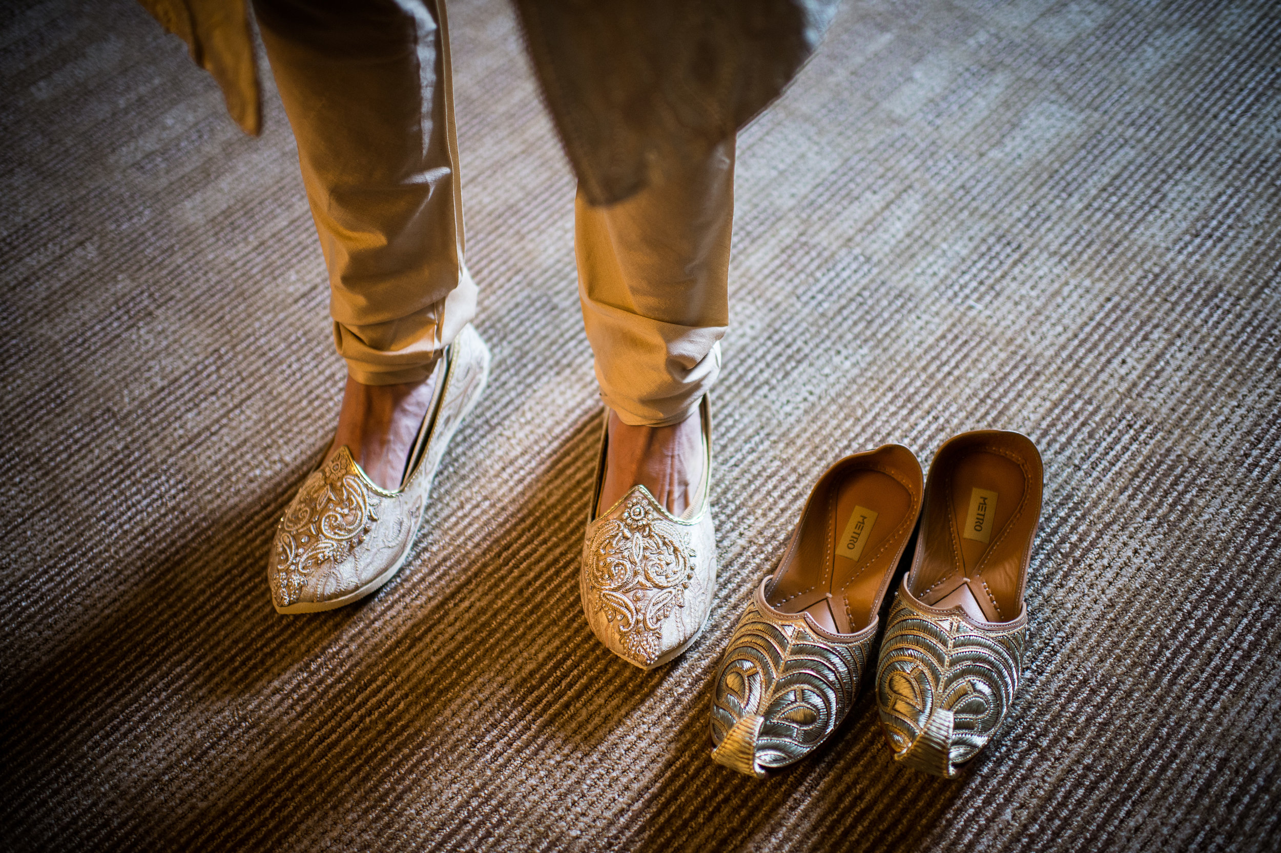 Indian groom putting on Shoes.JPG