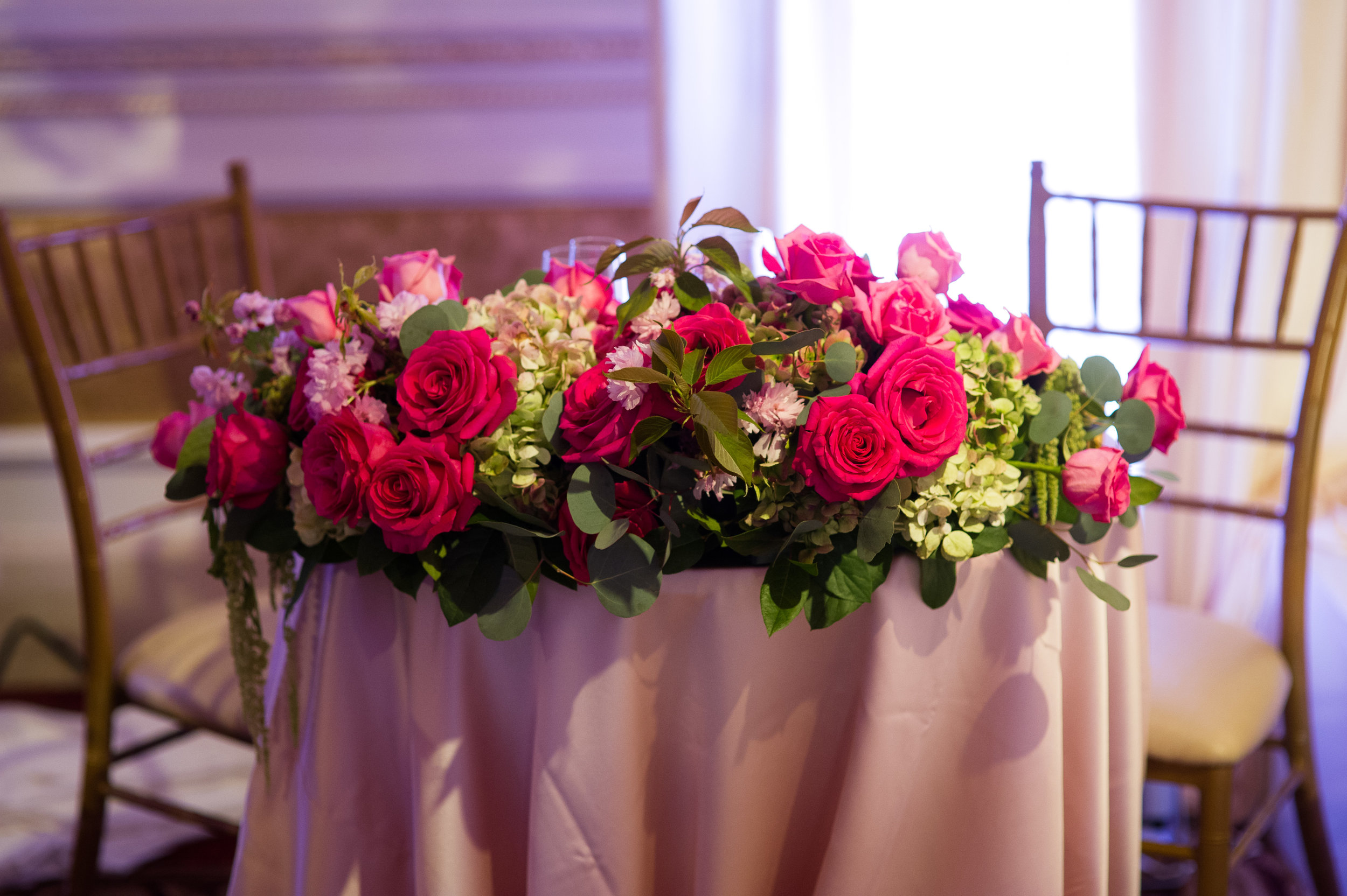 sweetheart table with floral centerpiece.JPG