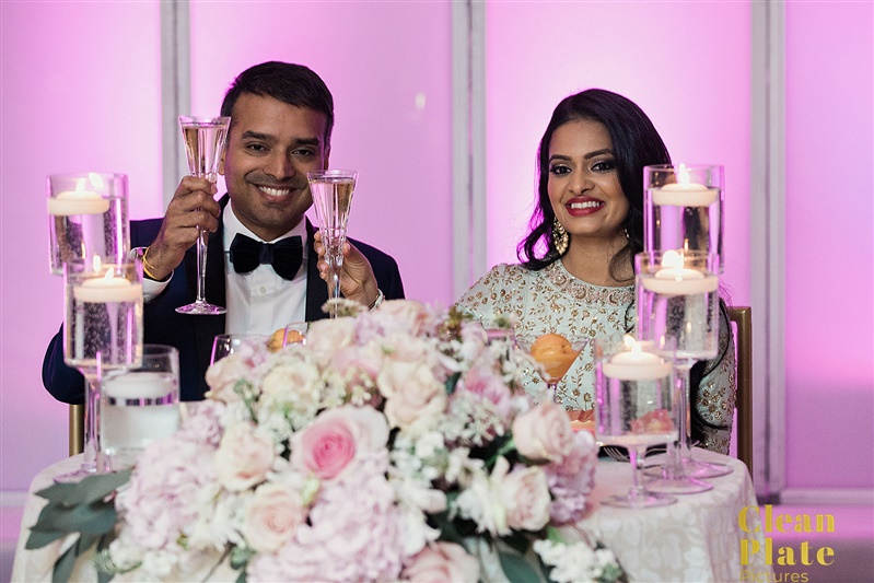 INDIAN WEDDING BRIDE AND GROOM AT DINNER TABLE.jpg