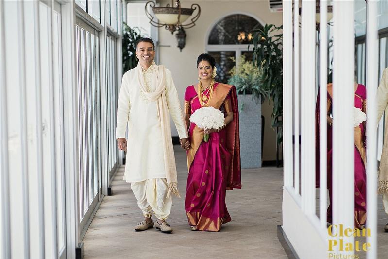 INDIAN WEDDING BRIDE WITH FLOWERS AND GROOM WALKING.jpg