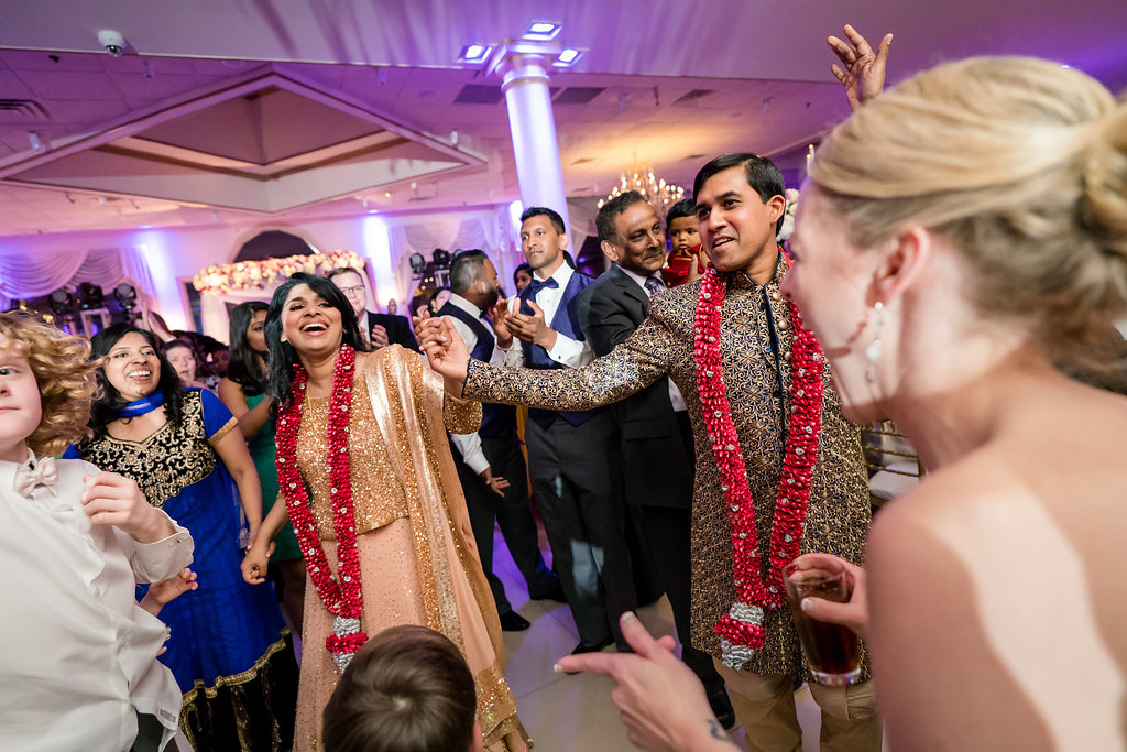 INDIAN WEDDING BRIDE AND GROOM DANCE WITH FAMILY2.jpg
