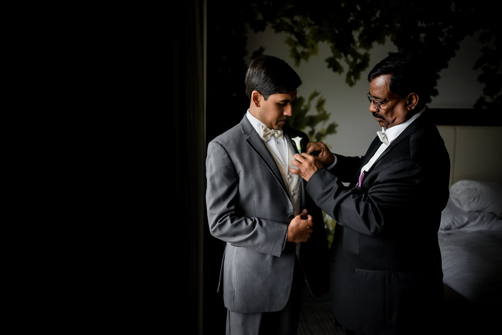 INDIAN WEDDING GROOM AND FATHER GETTING READY.jpg