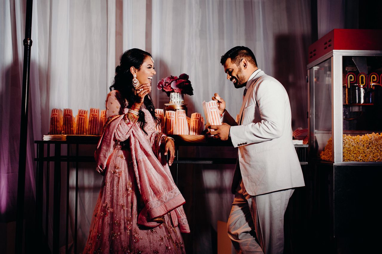 INDIAN WEDDING BRIDE AND GROOM AT POPCORN STAND.jpg