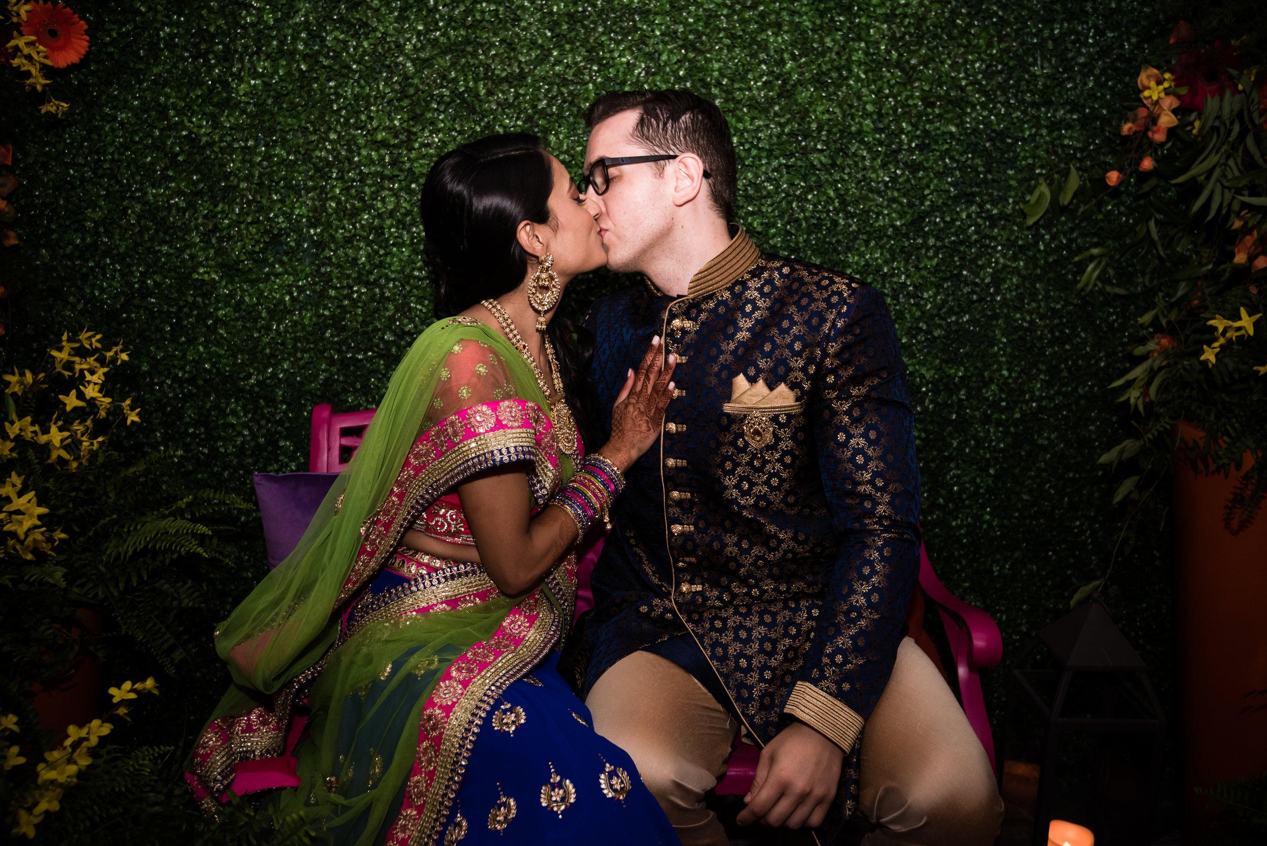 INDIAN WEDDING SANGEET BRIDE AND GROOM KISS.jpg