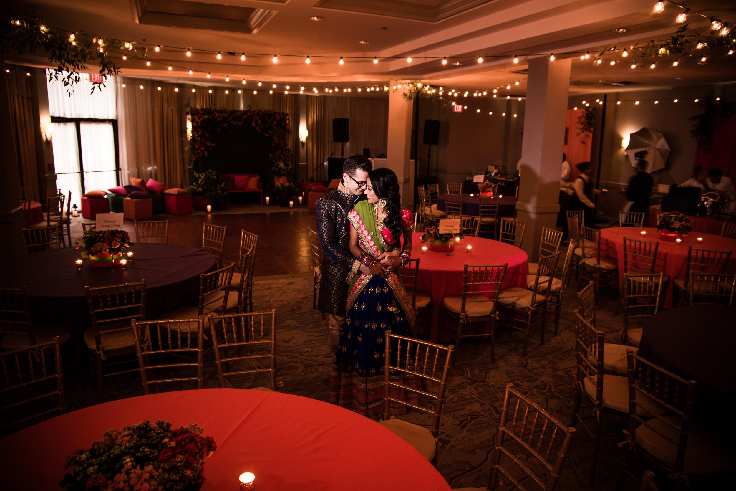 INDIAN WEDDING SANGEET BRIDE AND GROOM WITH VENUE DECOR.jpg