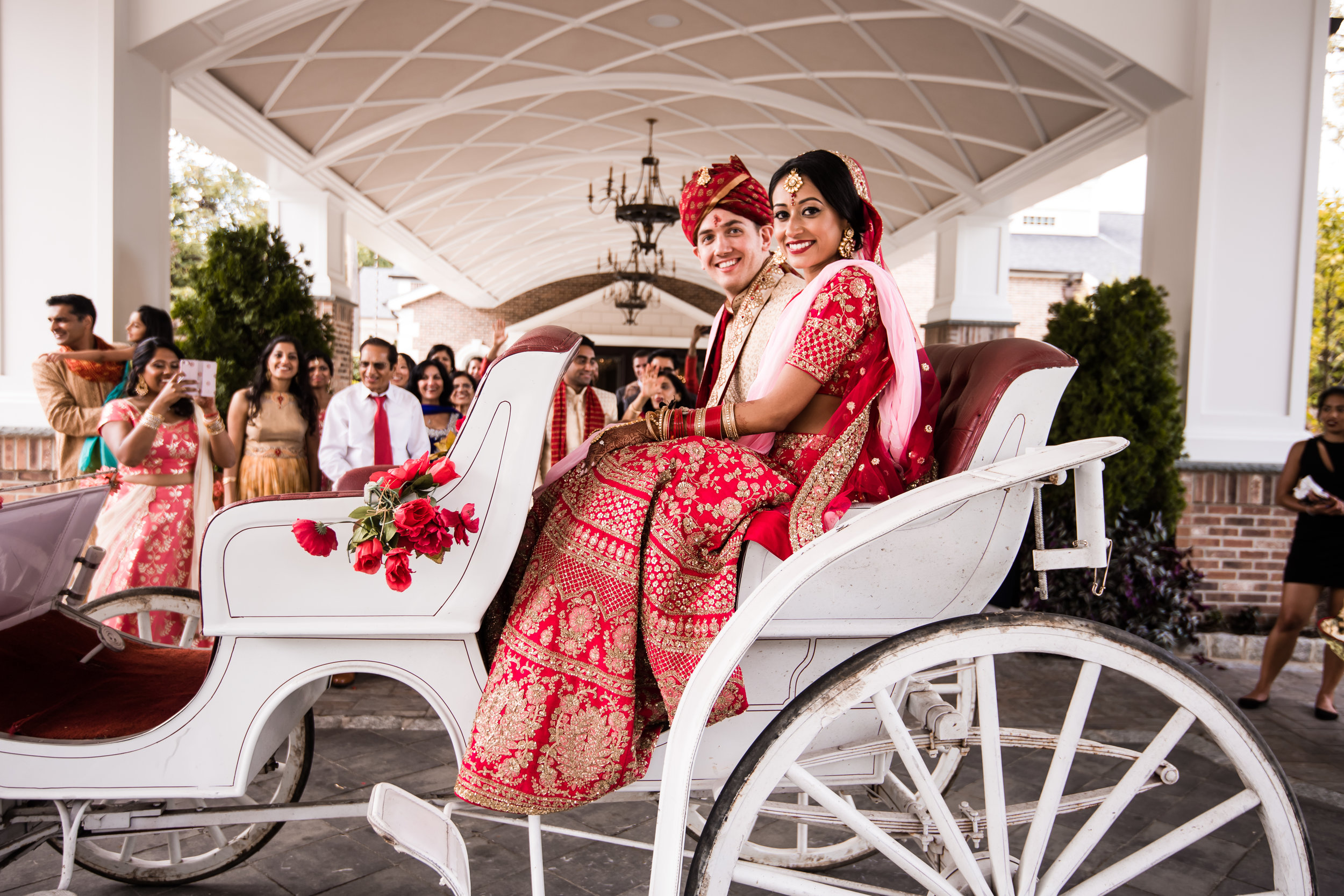 INDIAN WEDDING BRIDE AND GROOM ON CARRIAGE.jpg