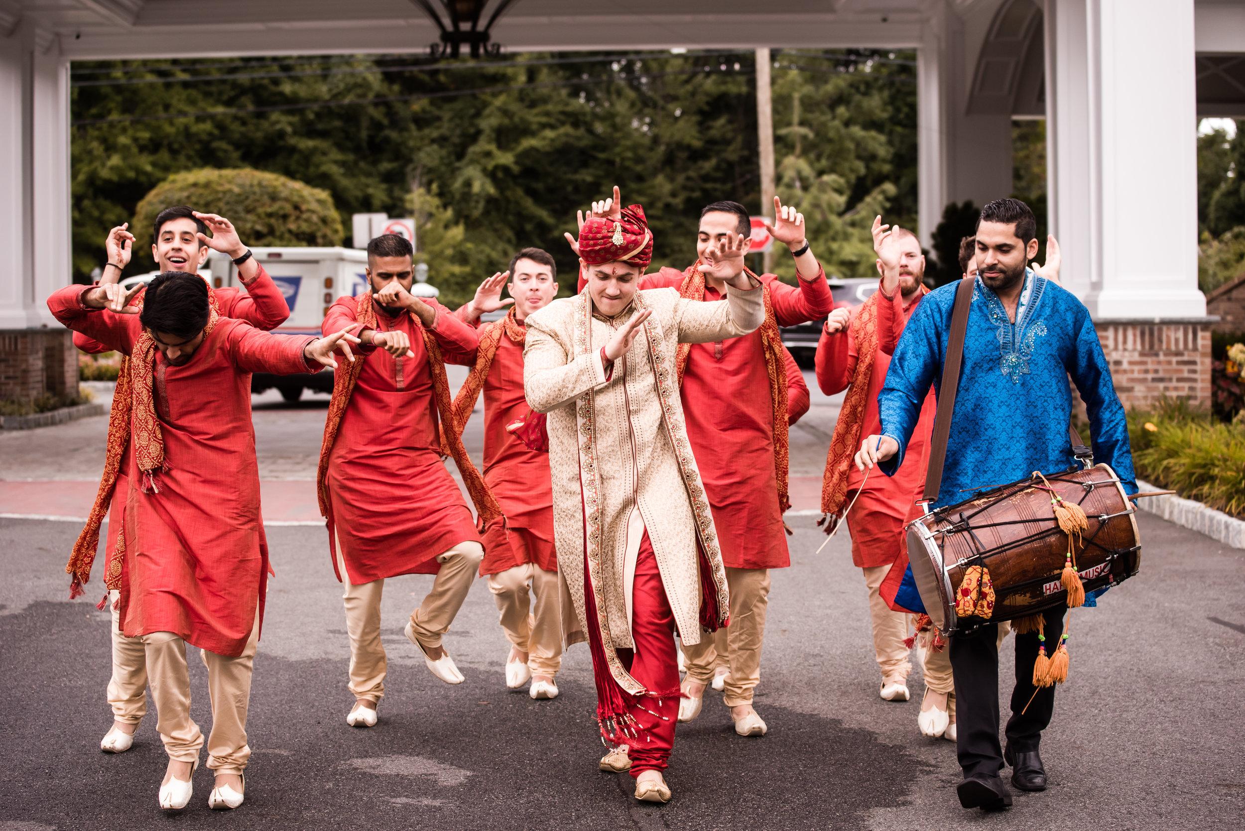 INDIAN WEDDING GROOM DANCING INTO CEREMONY.jpg
