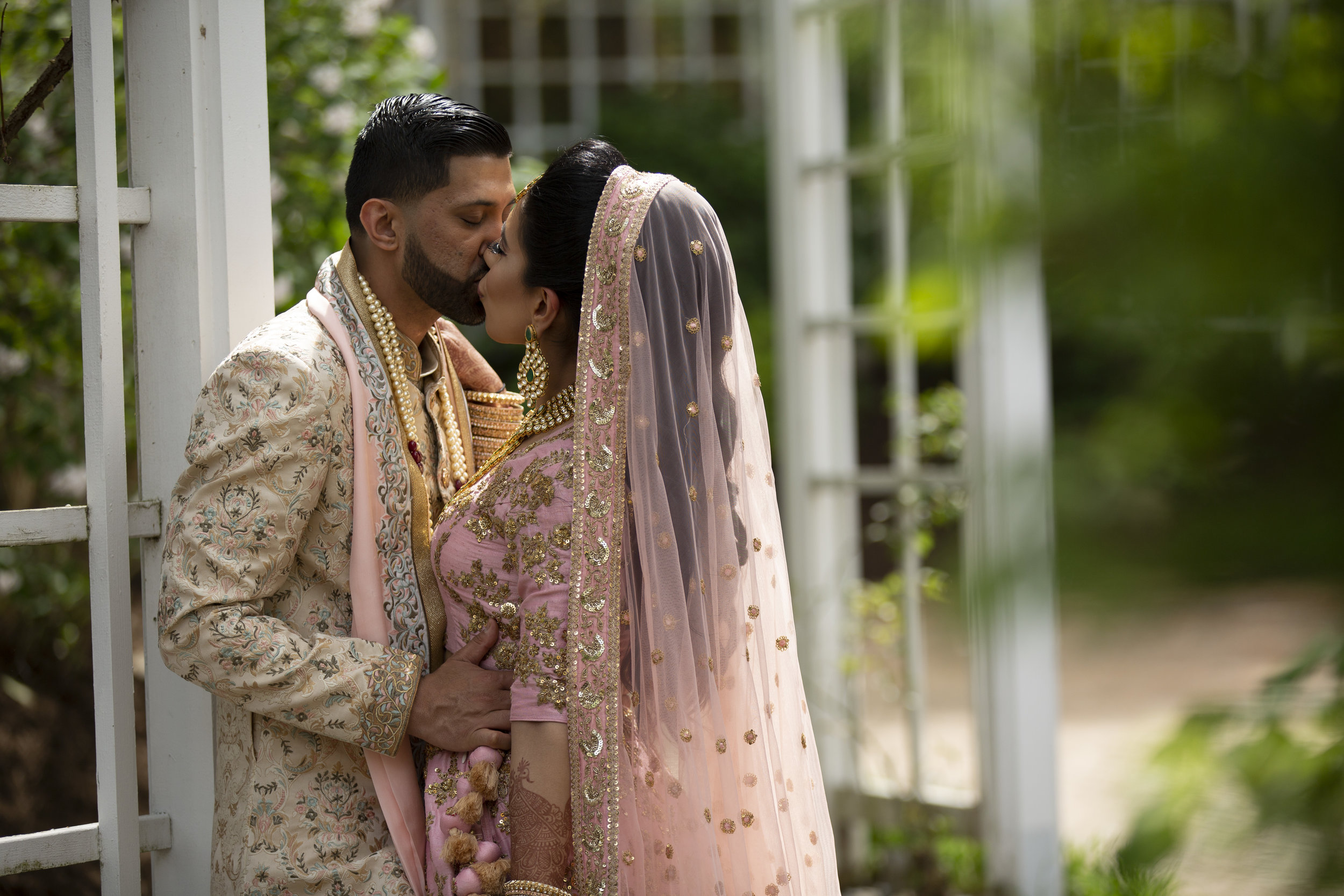 INDIAN WEDDING CEREMONY BRIDE AND GROOM KISS.JPG