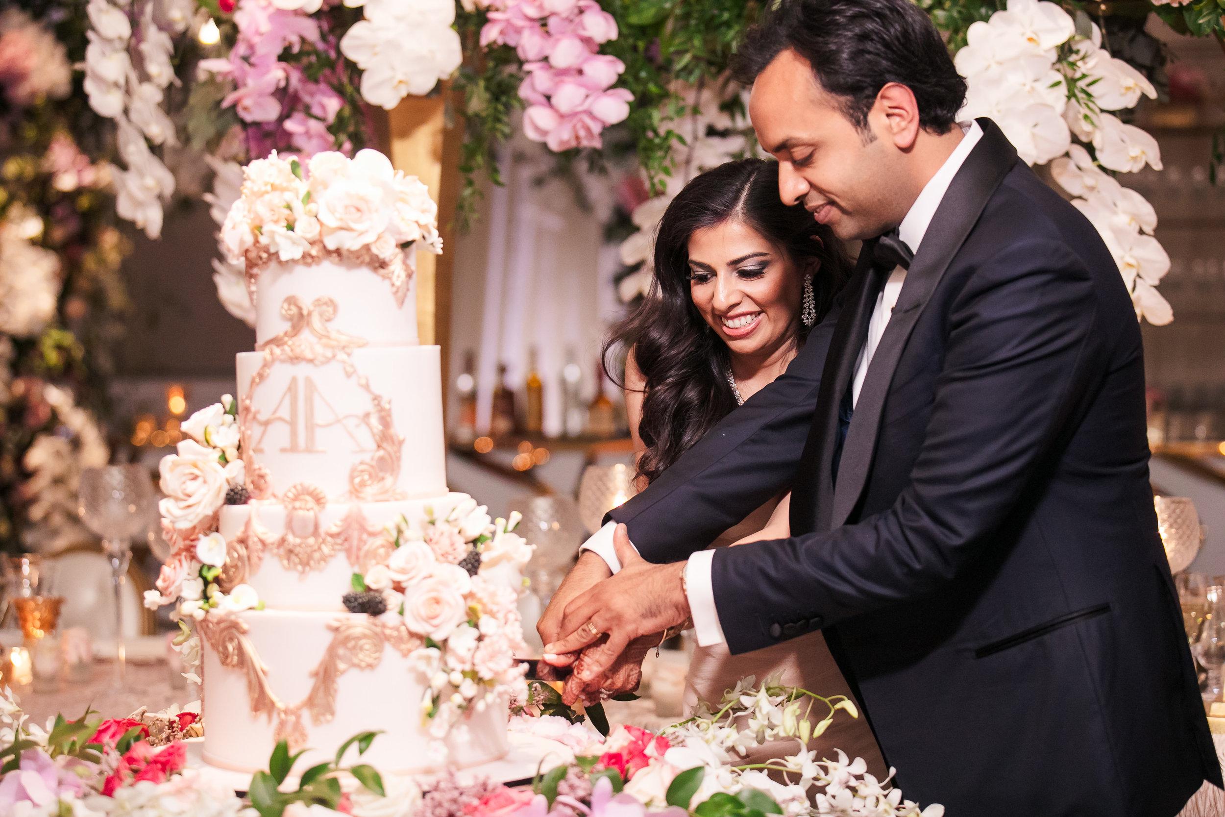 INDIAN WEDDING BRIDE AND GROOM CUTTING CAKE.jpg
