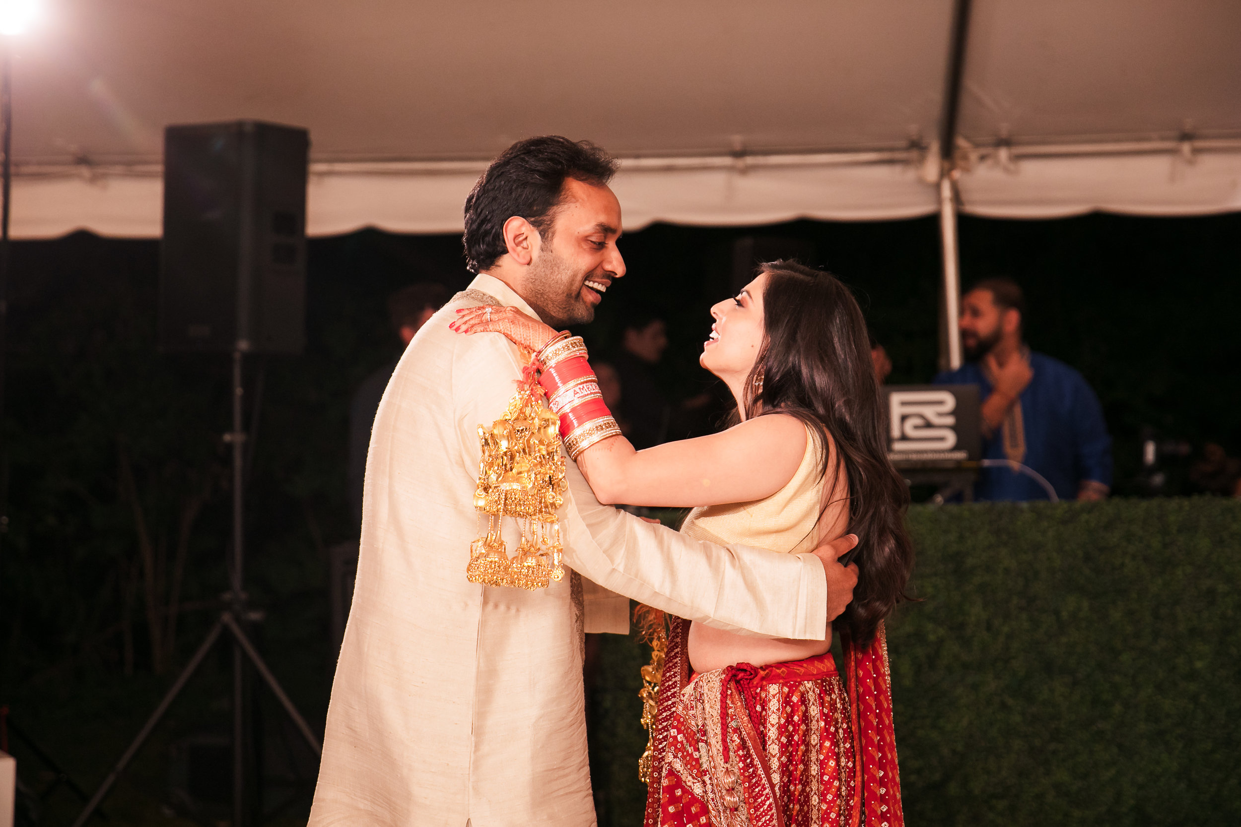 INDIAN WEDDING BRIDE AND GROOM DANCING.jpg