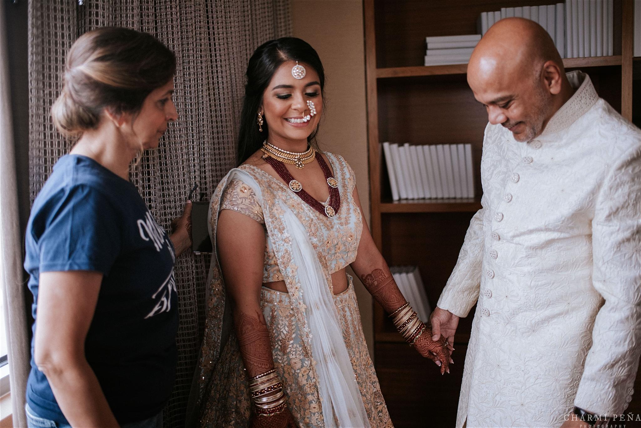 INDIAN WEDDING BRIDE AND PARENTS.jpg